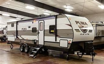 Outside view with outside kitchen to include griddle and grill.. Palomino Puma 2021