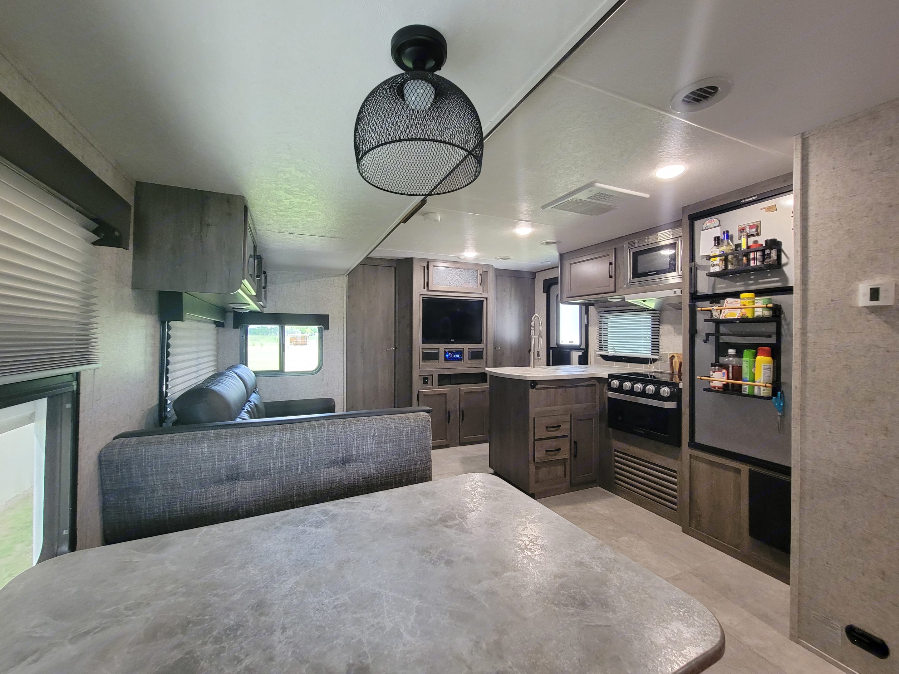 Room 2 Roam kitchen can accommodate any meal you have planned.  (Stove-top, Oven, and Microwave). Coachmen Apex 2021