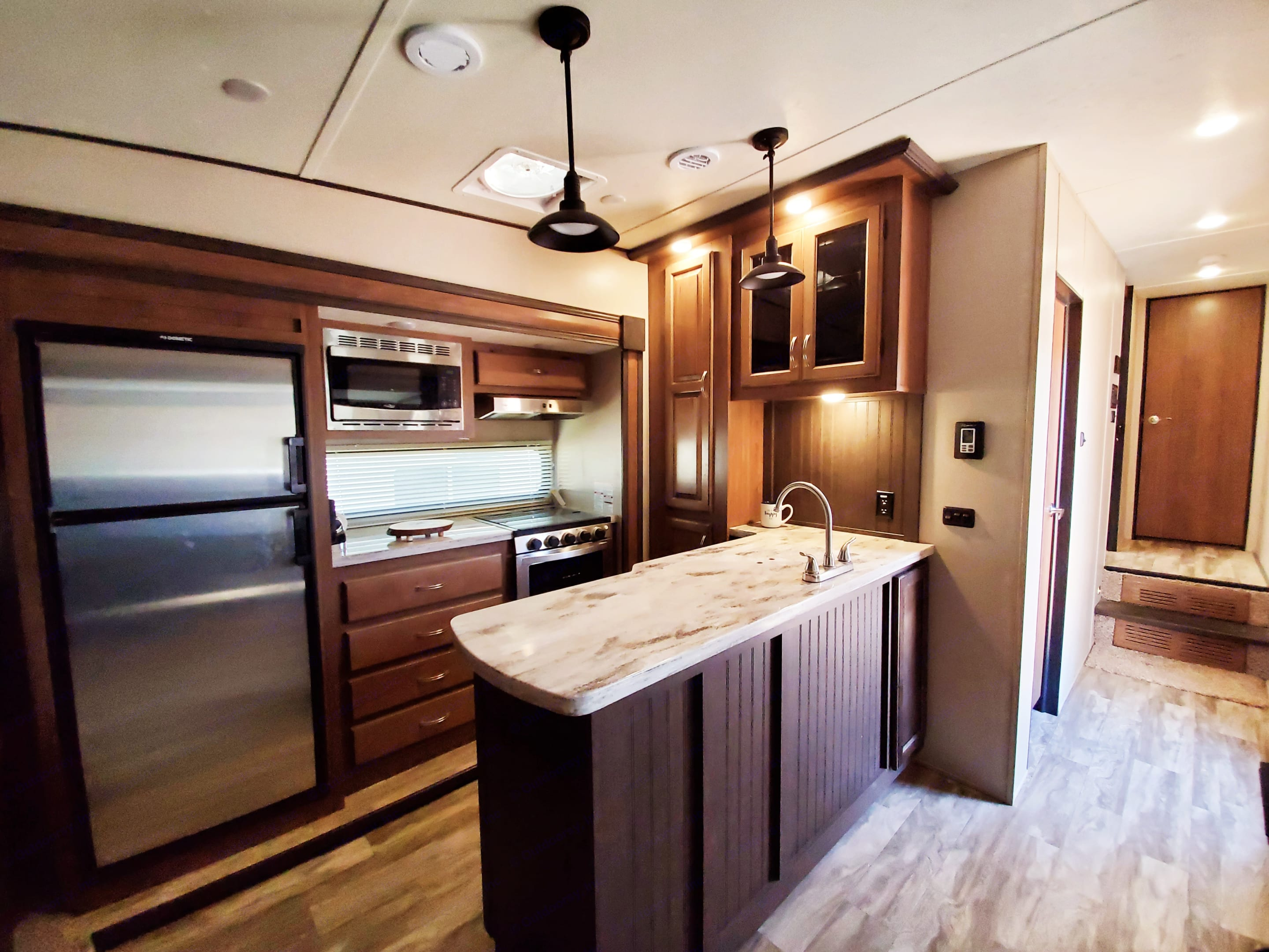 Fully equipped kitchen, including a portable ice maker and keureg!. Coachmen Chaparral 2020