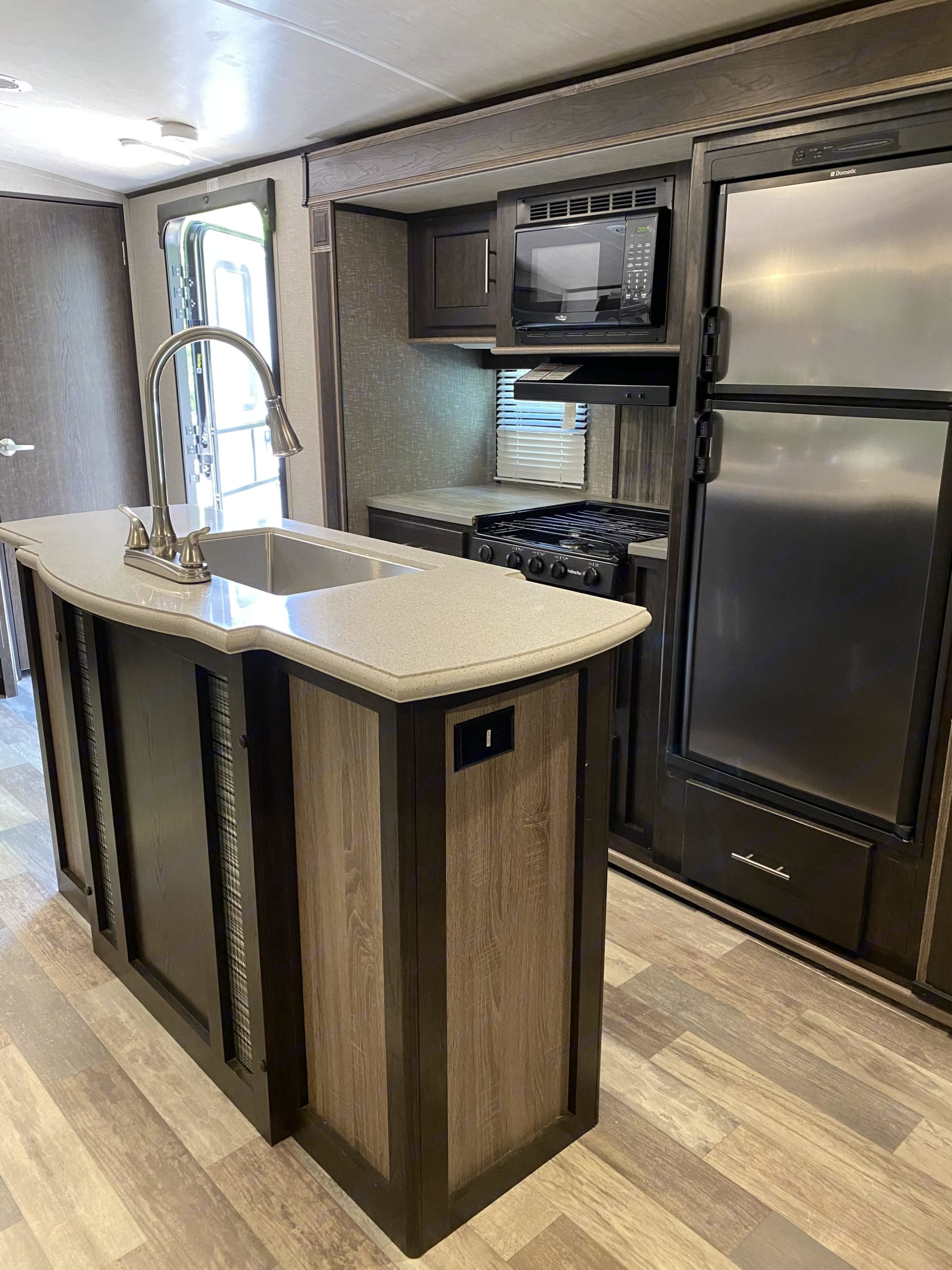 Large fridge and freezer, microwave, oven, stovetop, three workspaces for cooking, and large sink with spray faucet.. Cruiser Rv Corp Fun Finder 2017