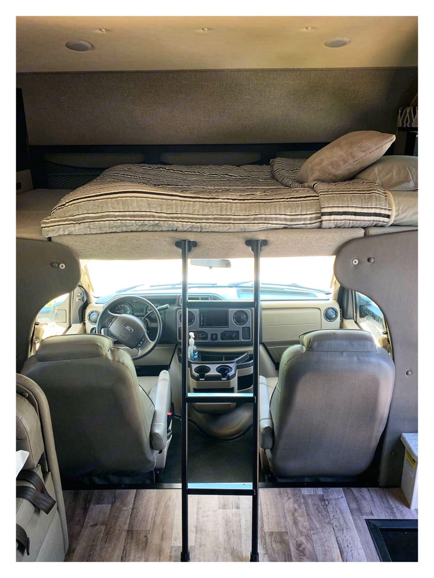 cockpit with full bunk above. Jayco Greyhawk 2020