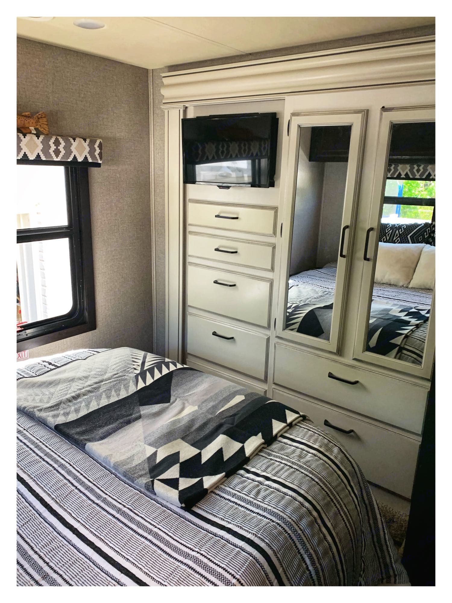 super cozy queen bed with foam topper, comforter, oversized pillows and Pendleton blanket, TV and plenty of storage. Jayco Greyhawk 2020