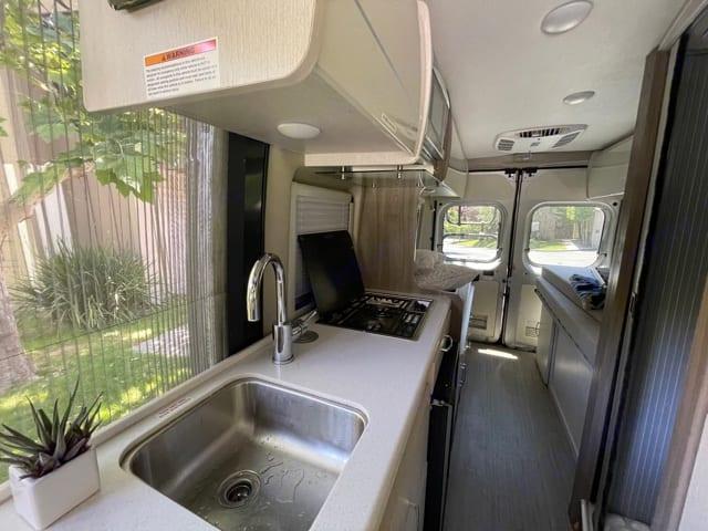 Includes sink, microwave, fridge and 2 burner stovetop. Thor Motor Coach Tellaro 2020