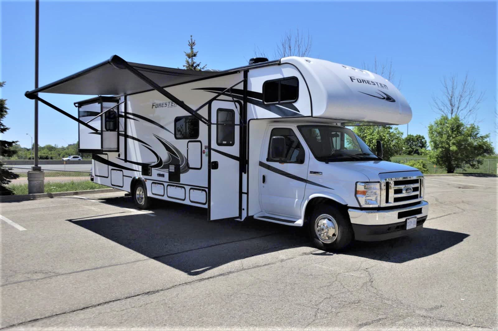 rv sun shade for relaxing outside . Forest River Forester 2021