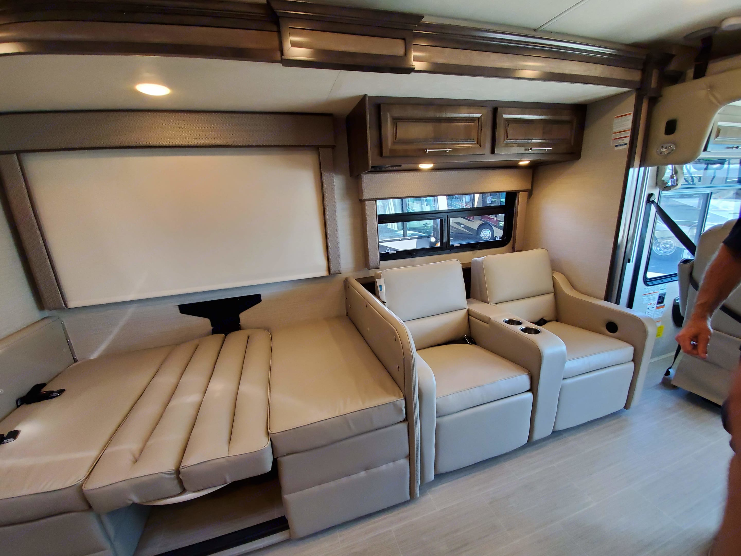 Dinette folds down to make a twin bed. Entegra Coach Vision XL 2020