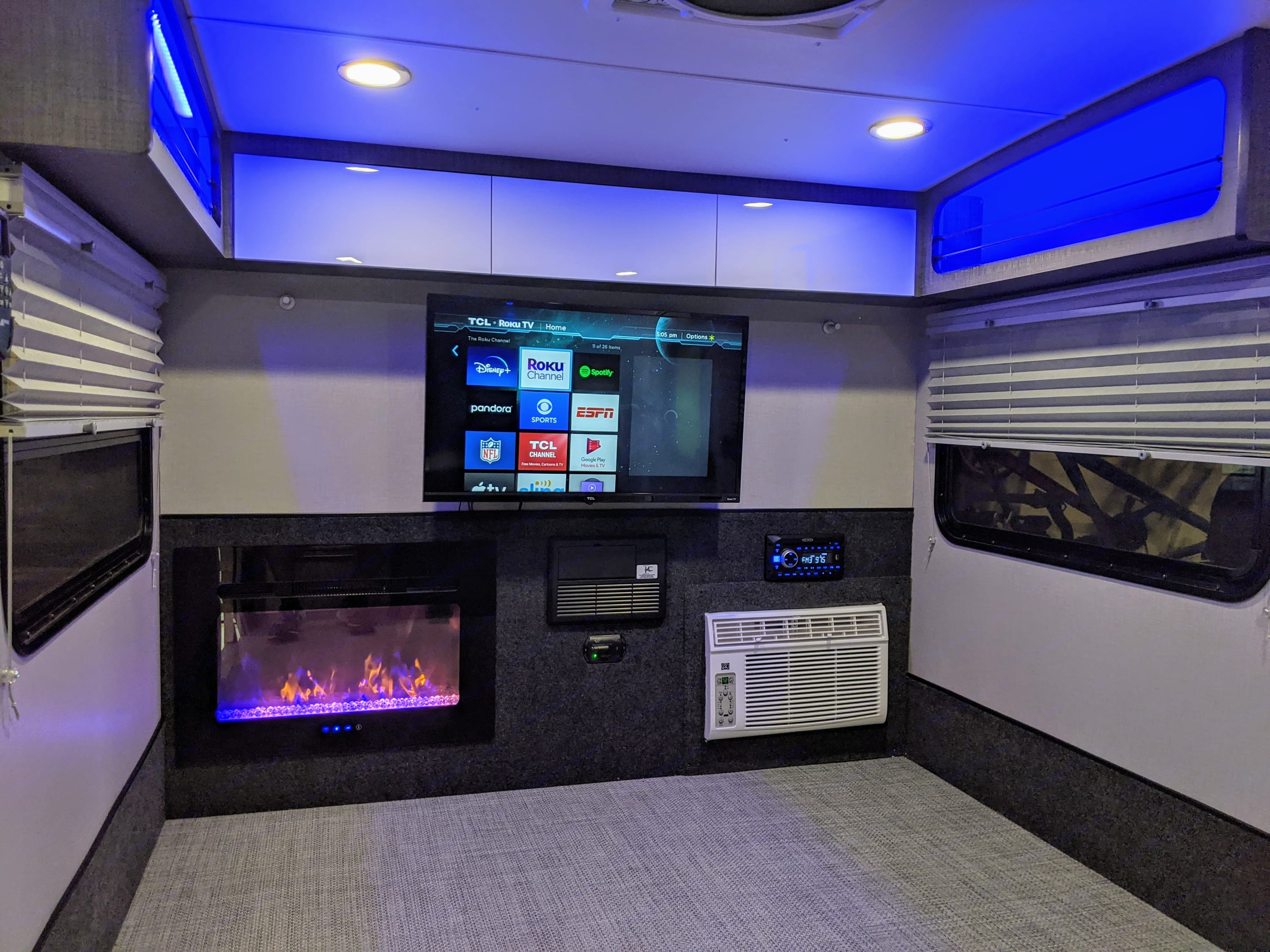A roomy space featuring a fireplace, AC, Stereo, and smart TV. . Other Other 2021