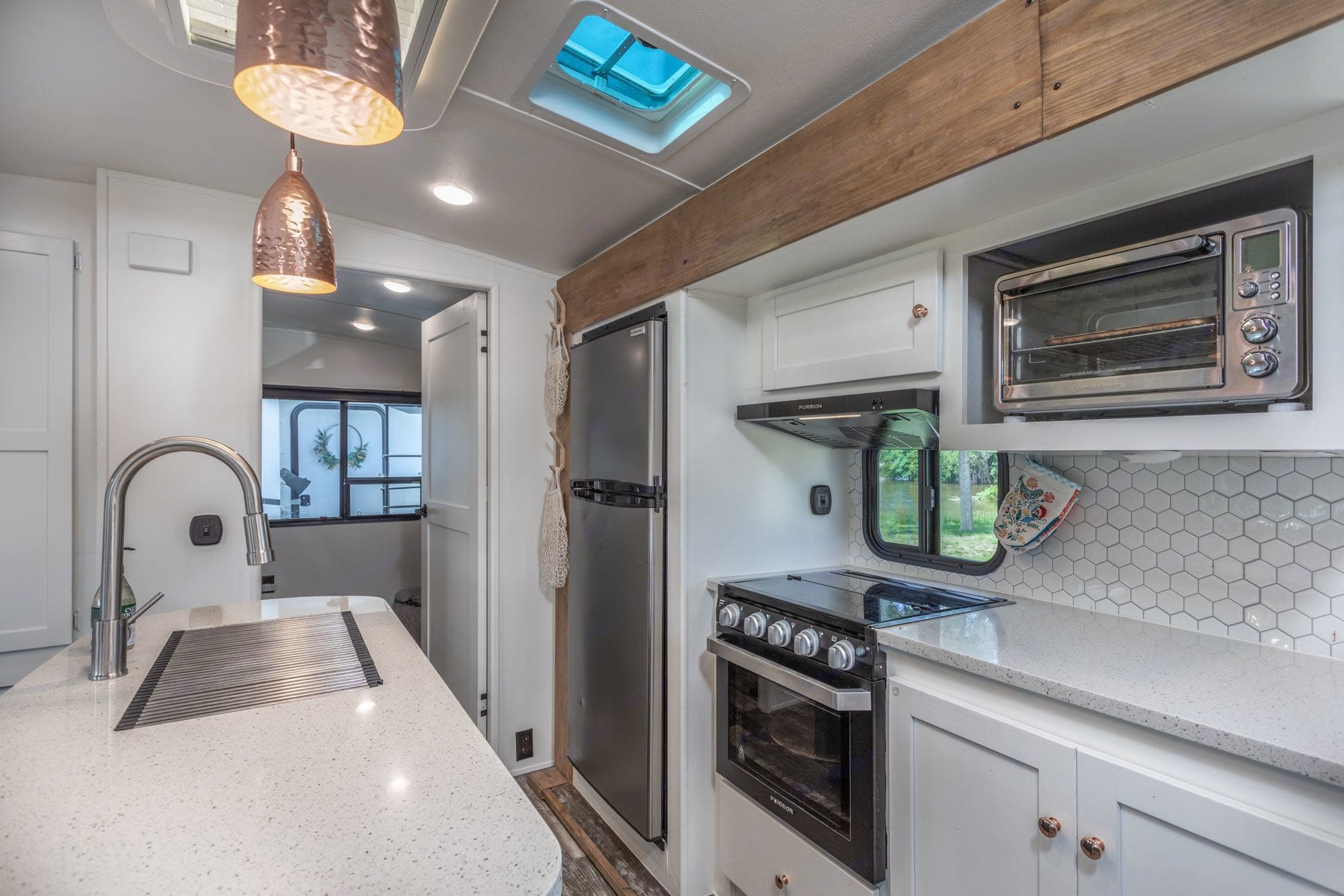 great storage in kitchen complete with all you need to cook meals while away. Pot, Pan, cooking utensils, plates, cups, eating utensils, strainer, griddle, instant pot, rags, coffee pot, oven mitts. Keystone Outback 2019