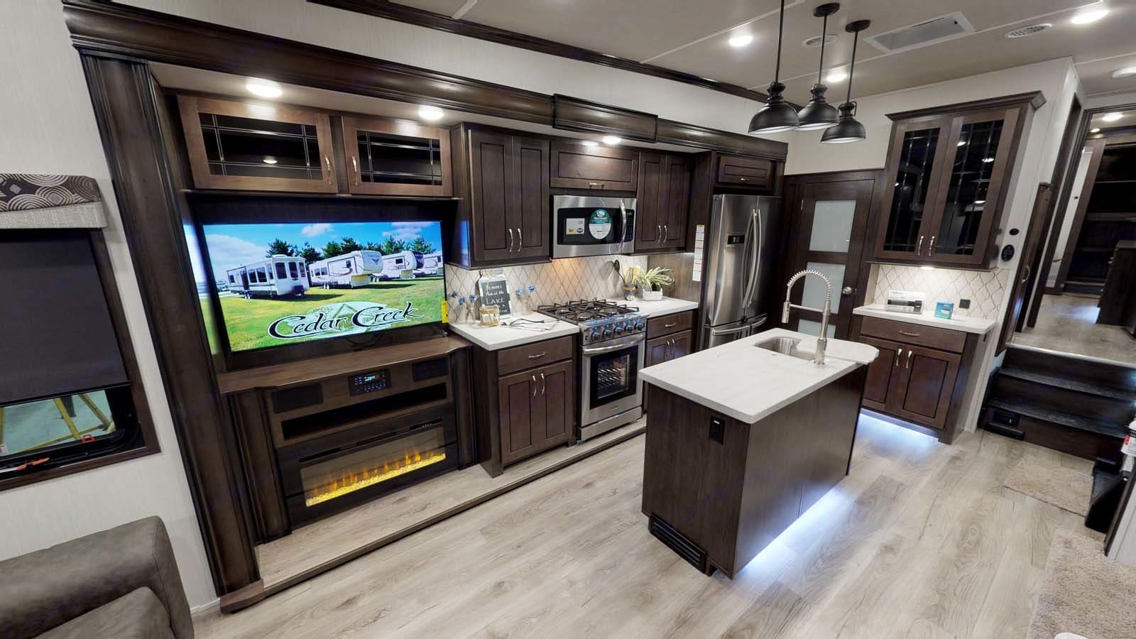 Anything but roughing it!  Residential refrigerator and the largest stove in any RV.  . Forest River Cedar Creek Silverback 2021