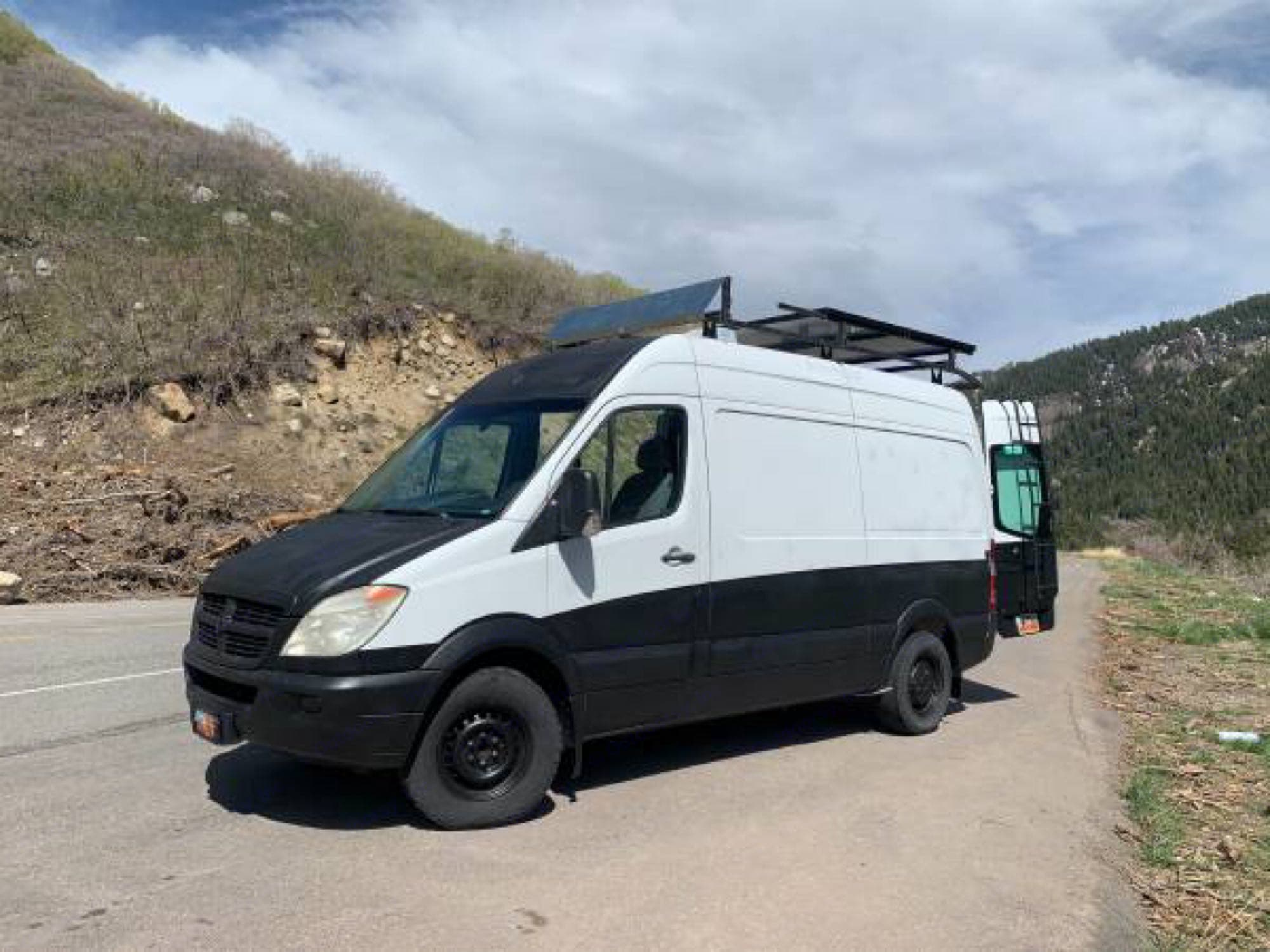 Exterior of the van is wrapped in truck bed liner, so picking up rocks on dirt roads is not an issue.. Dodge Sprinter Van 2008
