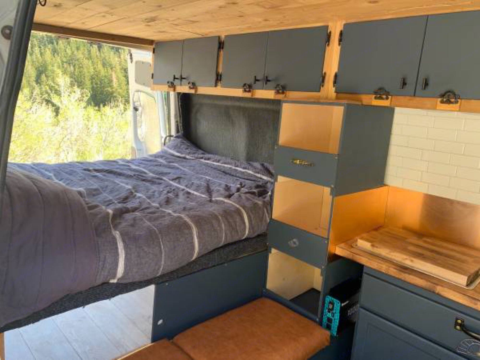 Bed is approximately Queen size. Can easily accommodate two people under 6 feet tall.. Dodge Sprinter Van 2008