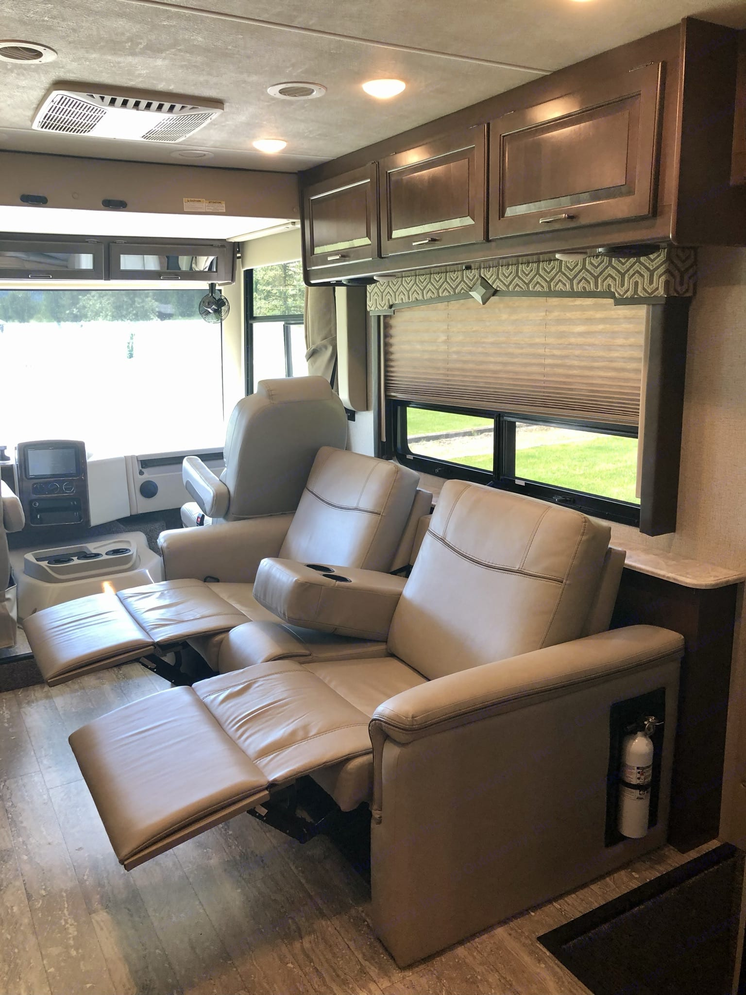 """This Thor Motorhome has a special touch with reclining chairs to watch your favorite movie on the 40"""" LED TV.. Thor Motor Coach Hurricane 2020"""