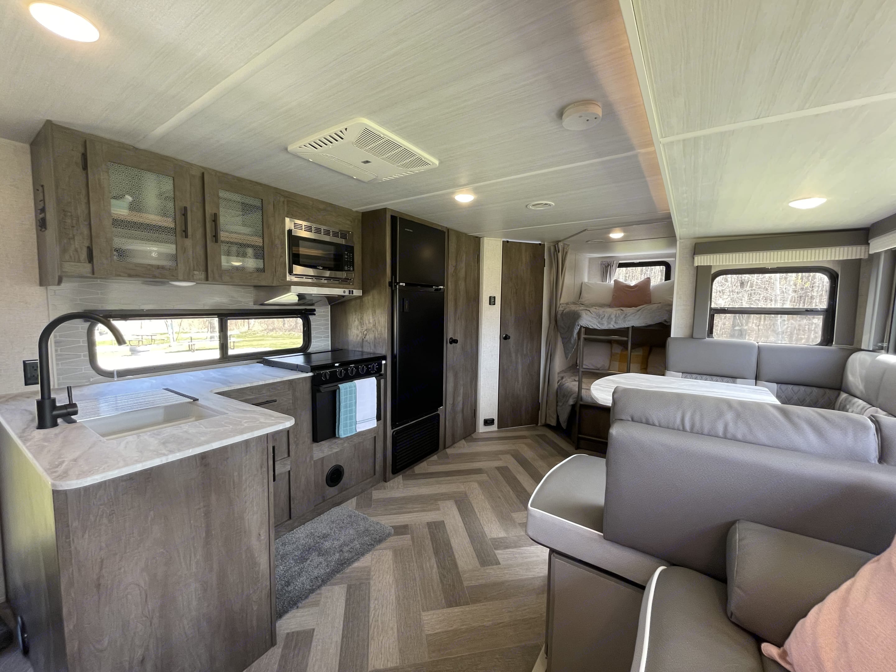 The spacious living and kitchen area is great for entertaining and hanging out in.. Forest River Salem Cruise Lite 2021