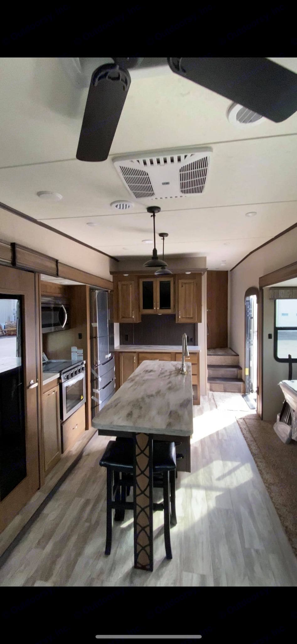 large island with barstools. Coachmen Chaparral 2020