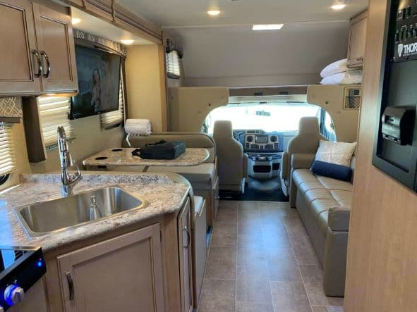Enjoy this room and functional dinning and living area (with large screen tv). Thor Motor Coach Chateau 2019