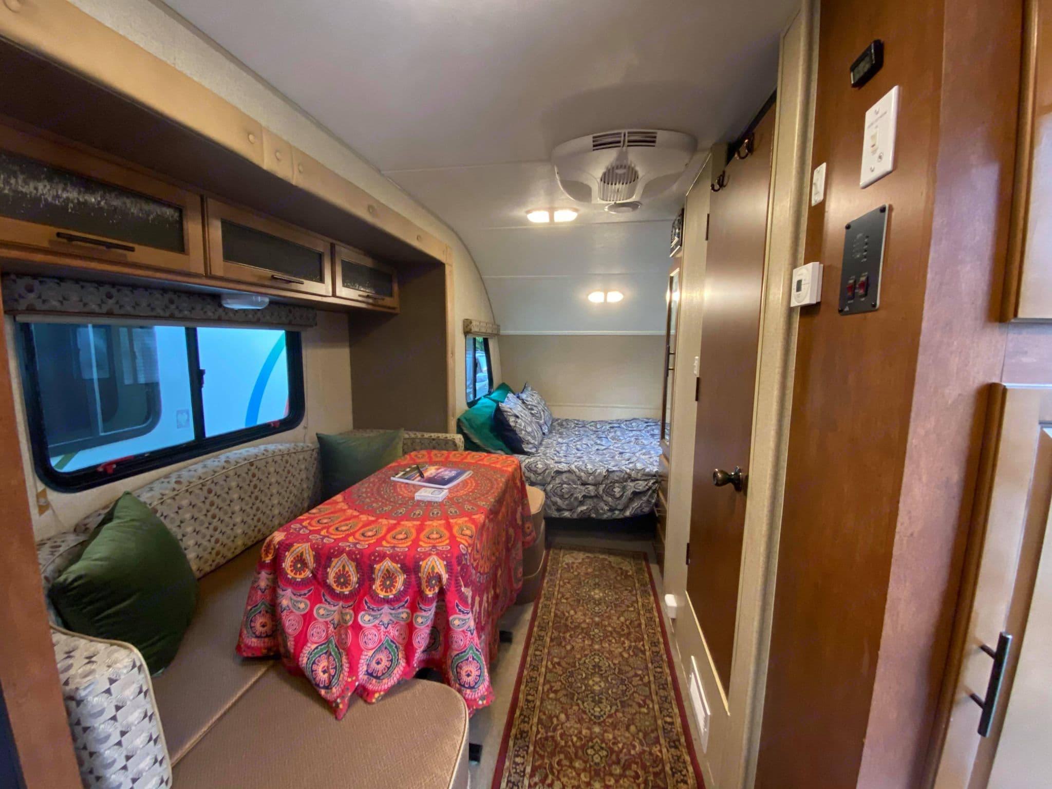The dinette area slides out for additional room inside the camper. Forest River R-Pod 2014