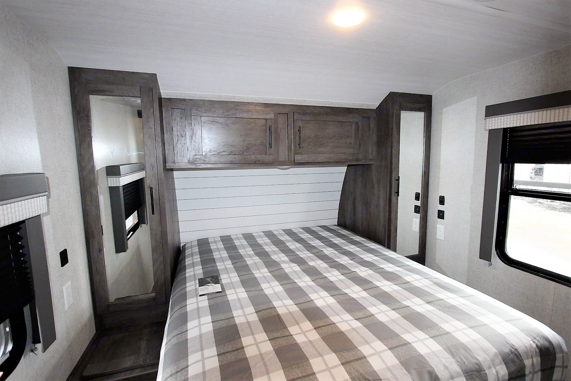 Queen bed with 2 closets, TV and an extra shelved closet. Snuggle up in this private room and rest up for tomorrow's adventures! . Forest River Salem 2021