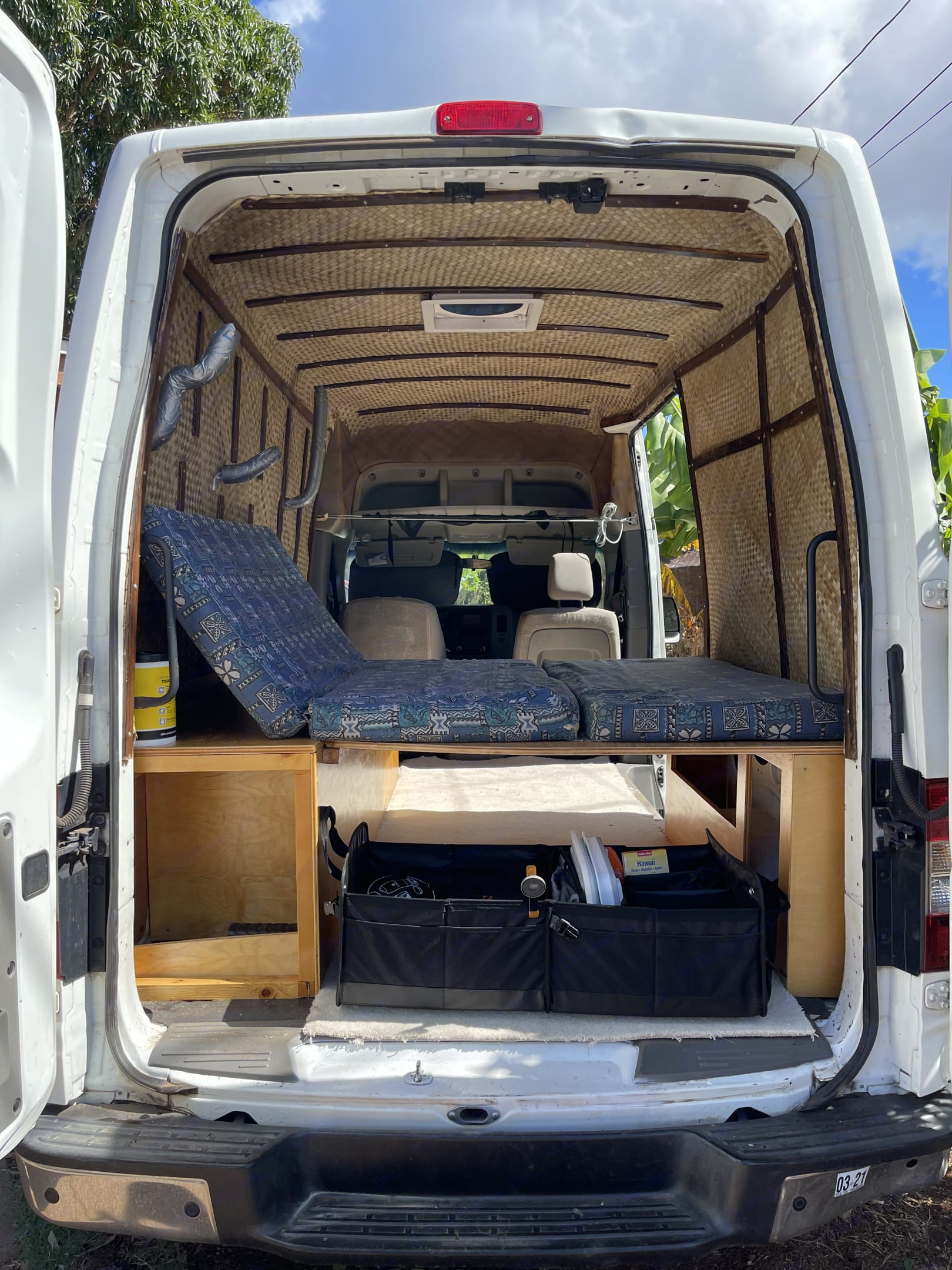Bed frame is retractable and there's lots of space. . Nissan Civillian 2013