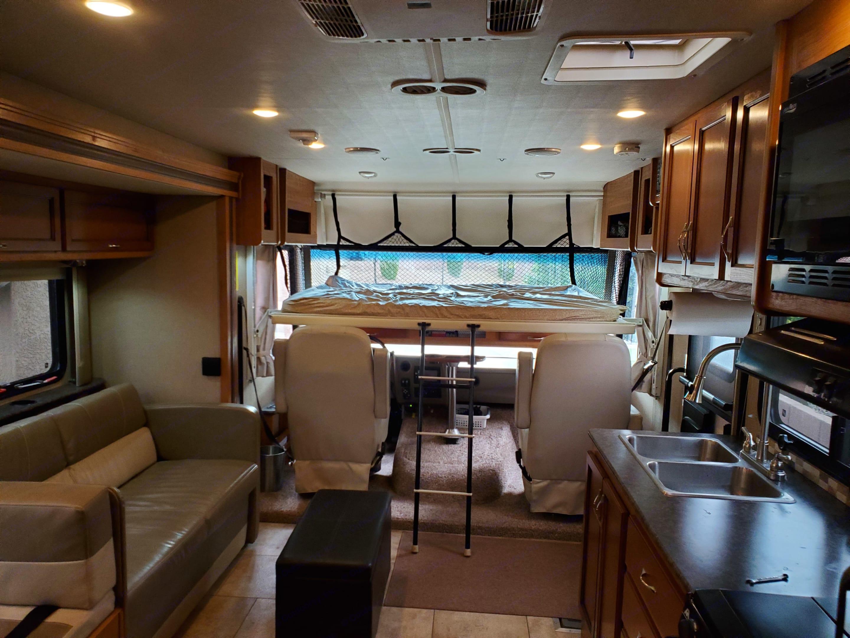 Drop down queen size bunk in driving area. Fleetwood Flair 2016