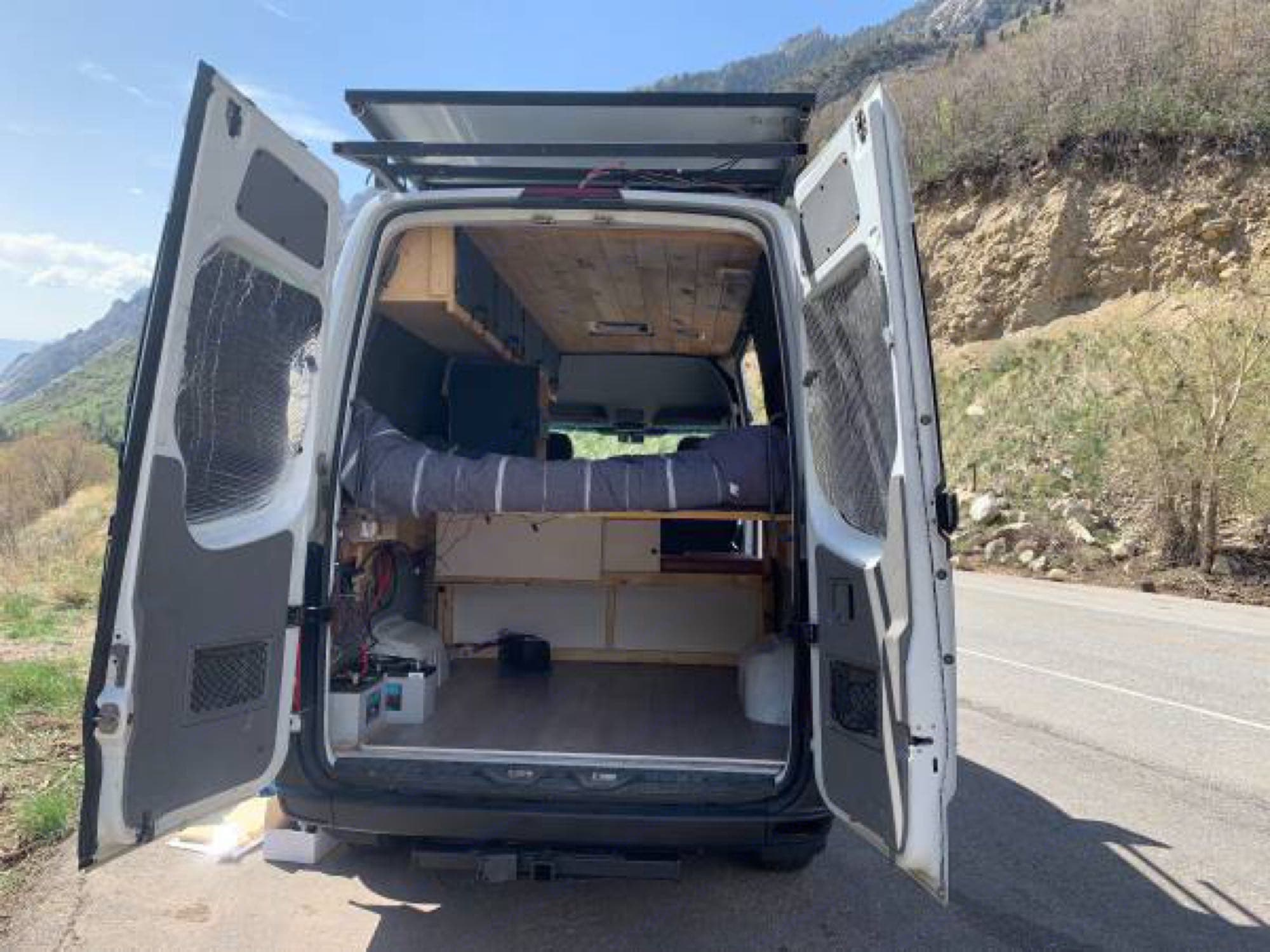 Large garage area will fit any gear you want to bring along, safely secured inside the van.. Dodge Sprinter Van 2008