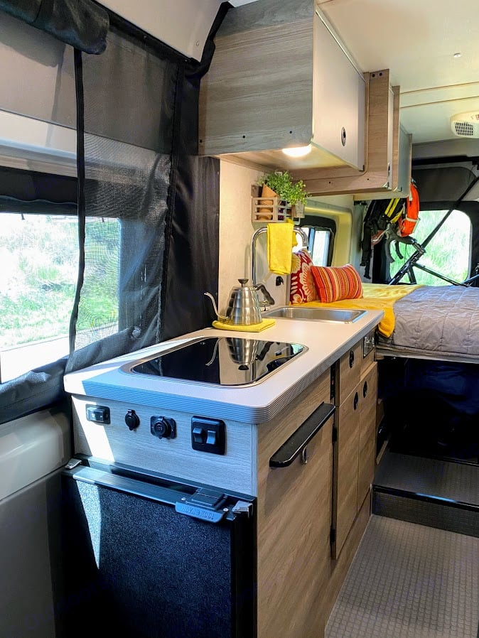 Dual-burner stove, fridge that's easy to access from outside, utensil drawer, sink, and plenty of storage.. Winnebago Solis 59PX 2022