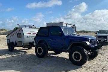 Roady enjoyed his off roading trip on the beach!. Coachmen Clipper 2021