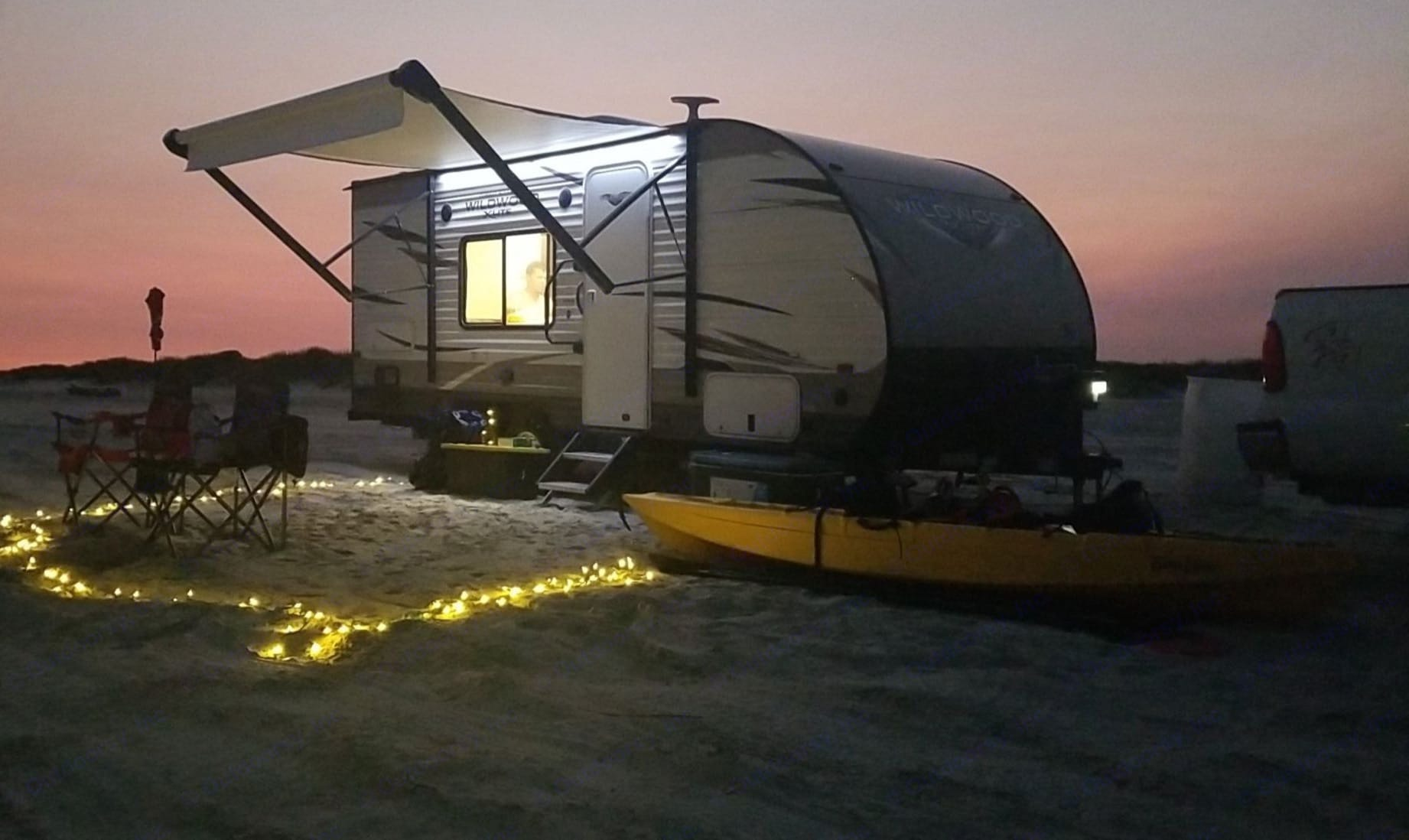 Beautiful sunset in Galveston,TX. boondocking 20 yards from the surf!!!. Forest River Wildwood X-Lite 2019