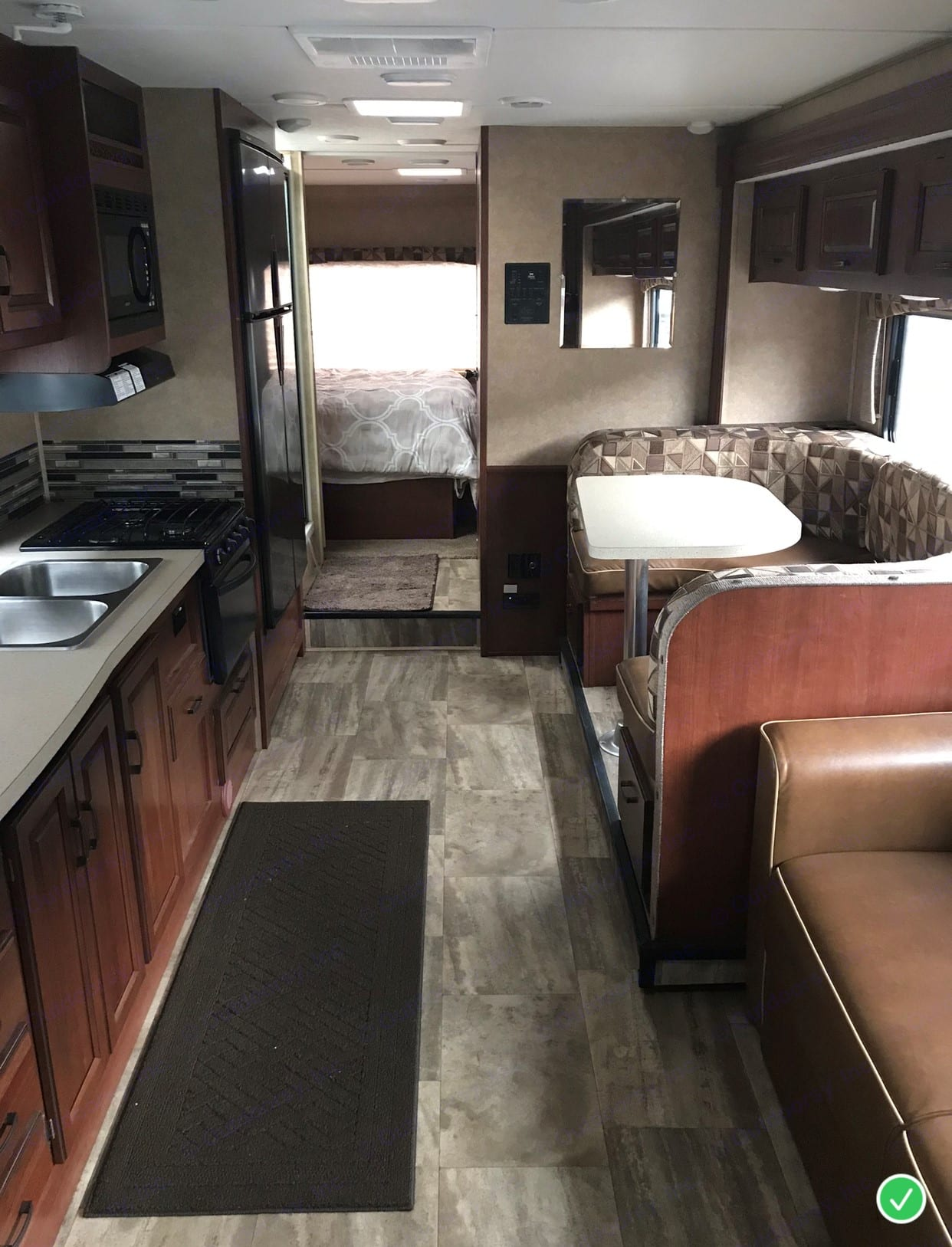 The kitchen has plenty of counter space and tons of storage.. Forest River Sunseeker 2015