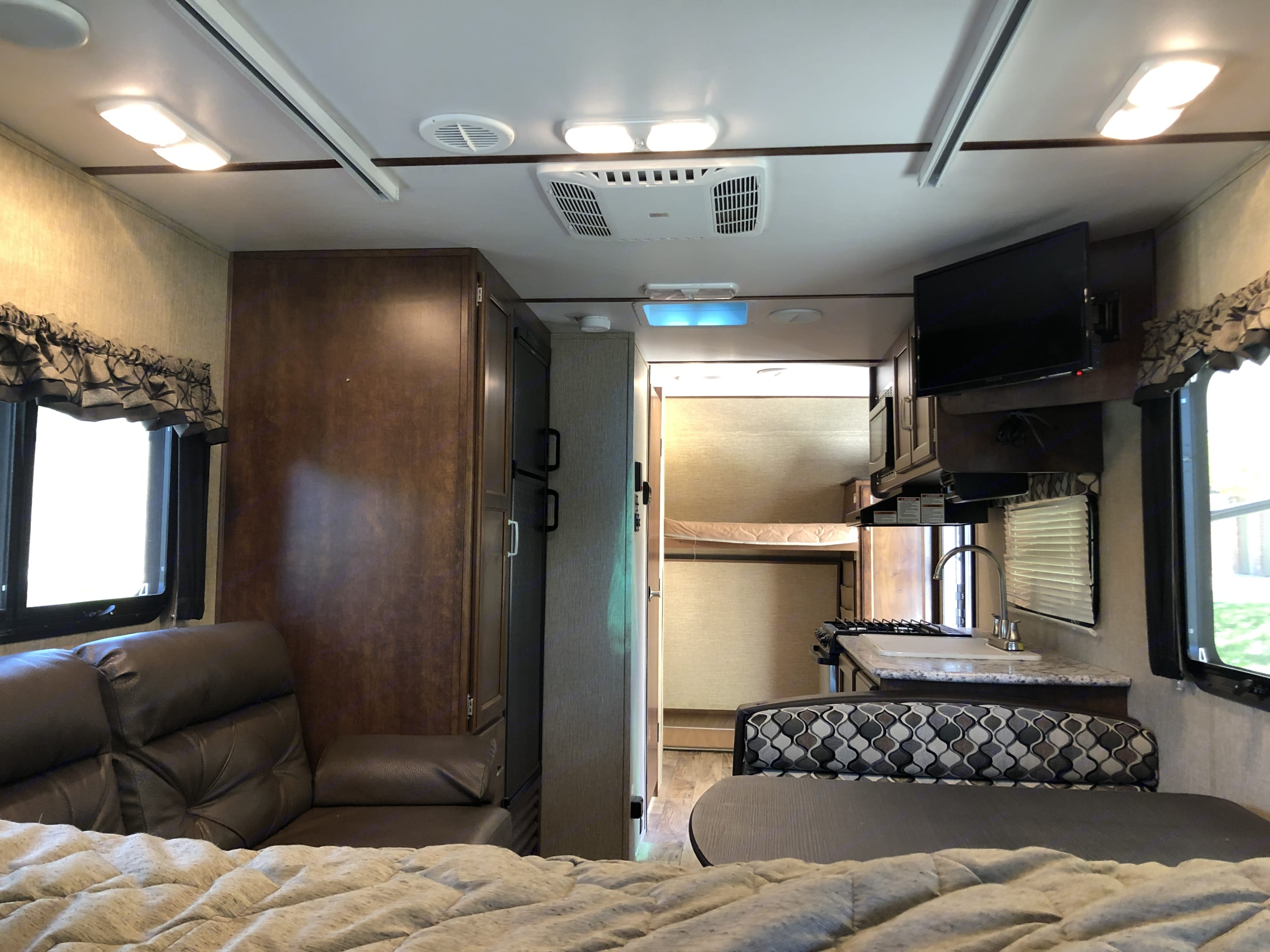 View from King Sized bed looking to front of camper (TV in top right). Keystone Outback UltraLite 2017