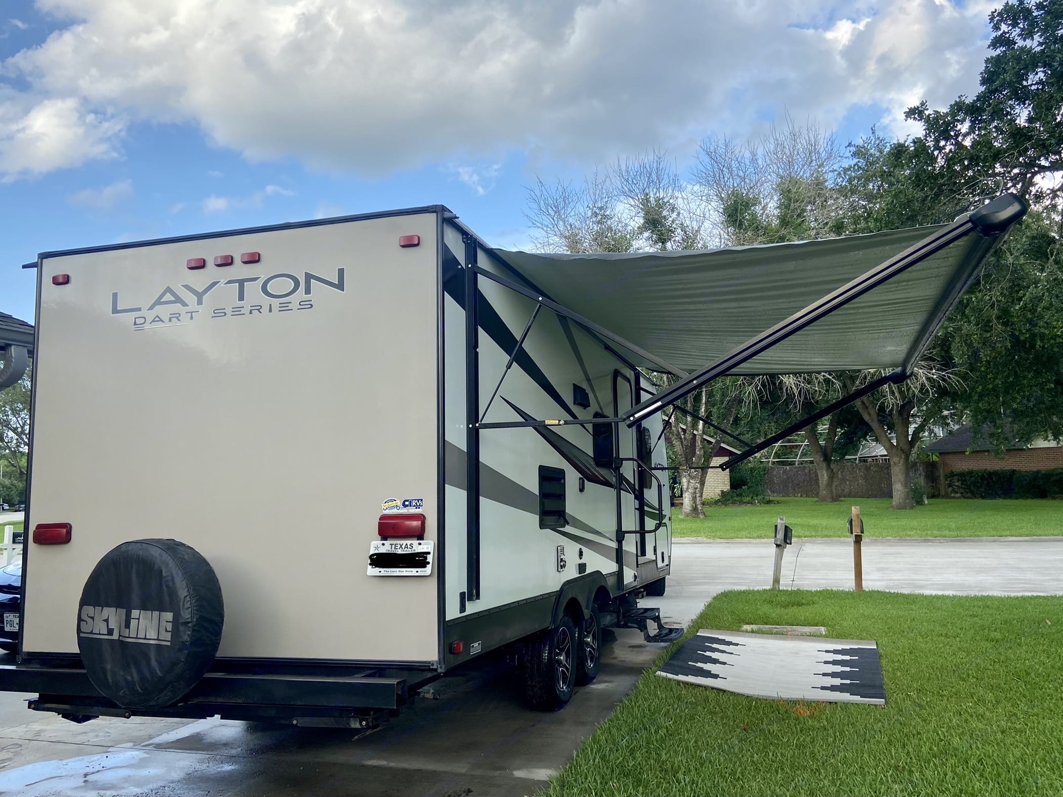Rear view with awning. Skyline Layton 2015