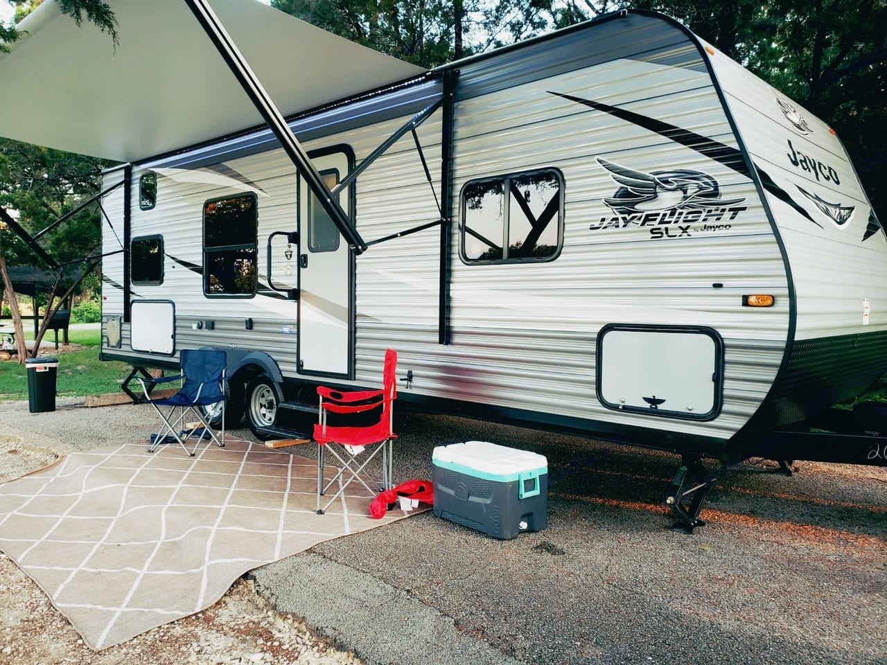 Outdoor rug, camping chairs, music, shade & fun, life is good!. Jayco Flight 264BH 2021