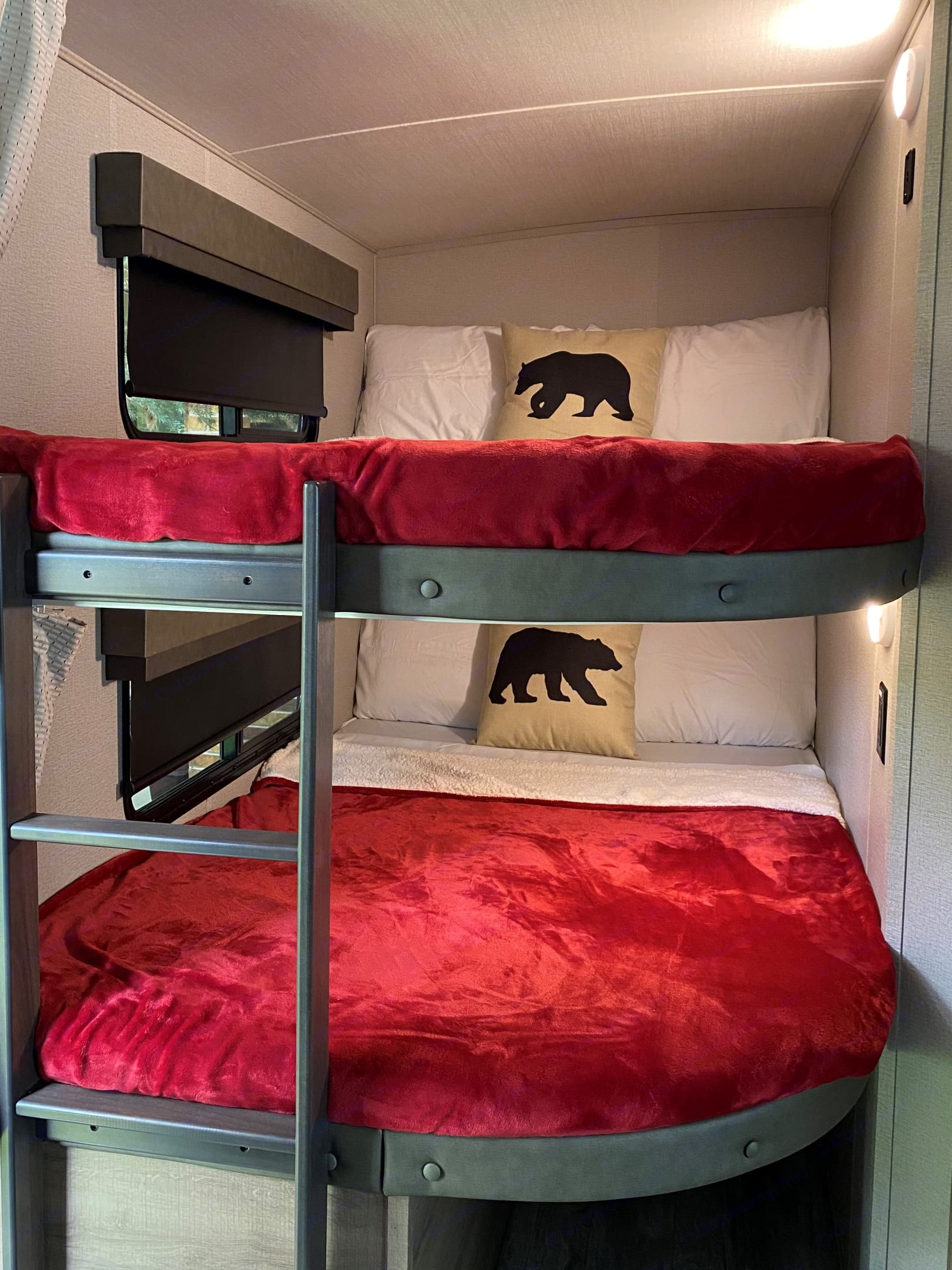 Bunkhouse with double beds and built-in ladder. Each bed has privacy curtains, sliding exterior window, USB outlet and personal light fixture.. Grand Design Imagine 2400BH 2021