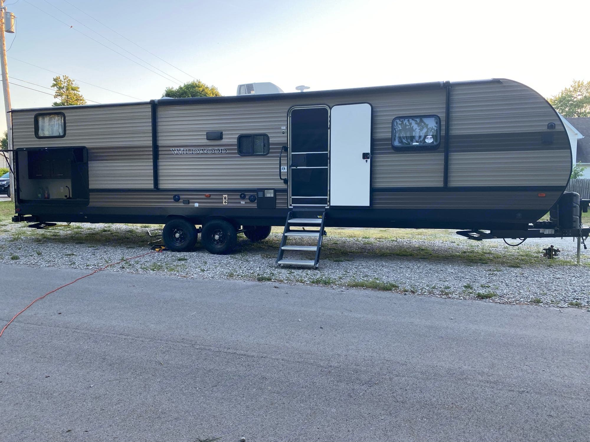 There is also a large awning that goes out an in with the touch of a button!. Forest River Wildwood 2020