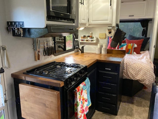 Kitchen with new butcher block countertops and a fold down counter extension for plenty of work space. . Winnebago Minnie Winnie 1999