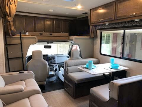 Roomy kitchen and living area.  TV above cab on swig arm.. Gulf Stream Conquest 2021