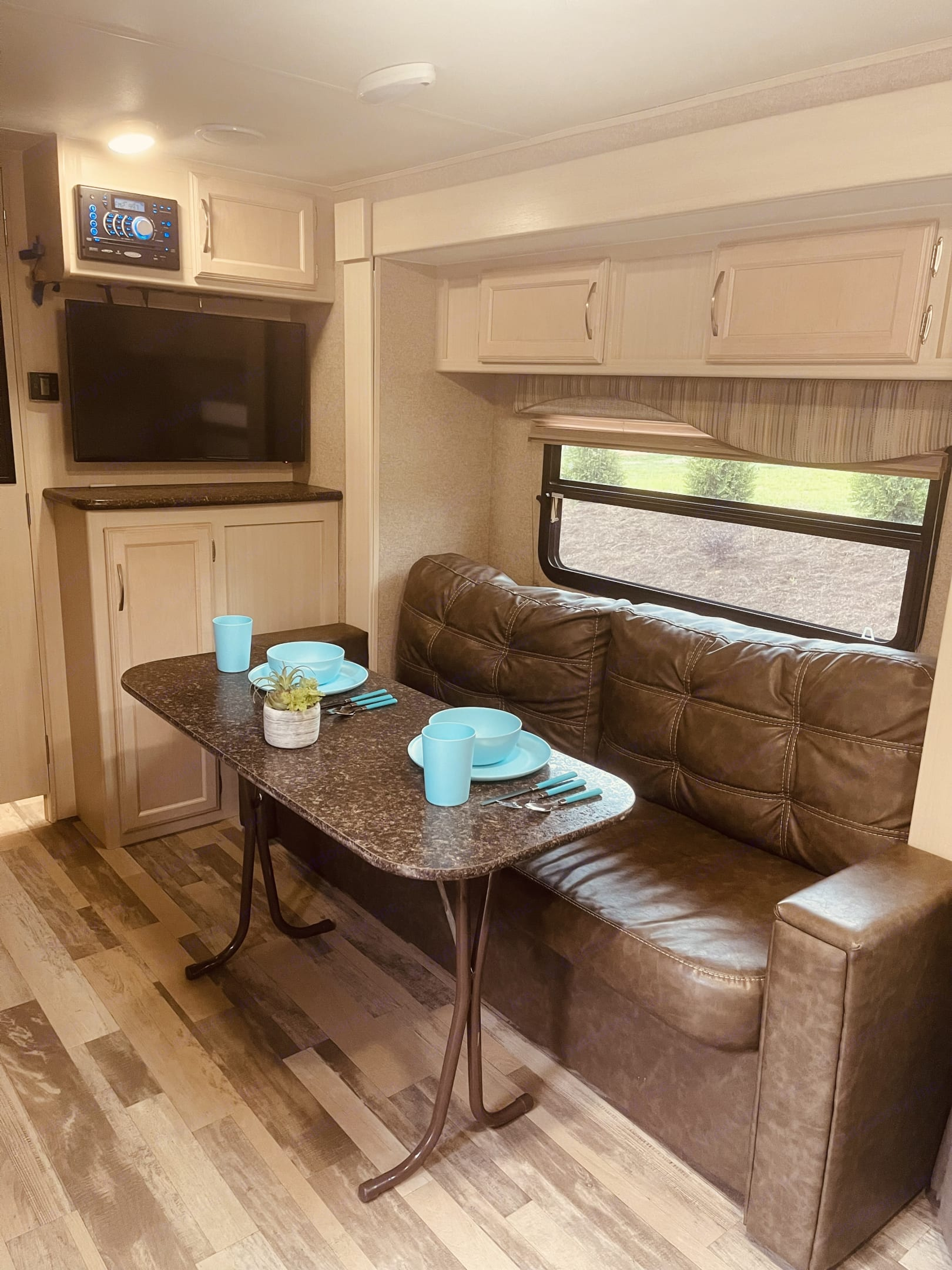Just grab the dining table from behind the sofa and pop out the legs and you are ready to eat.. Winnebago Micro Minnie 2017