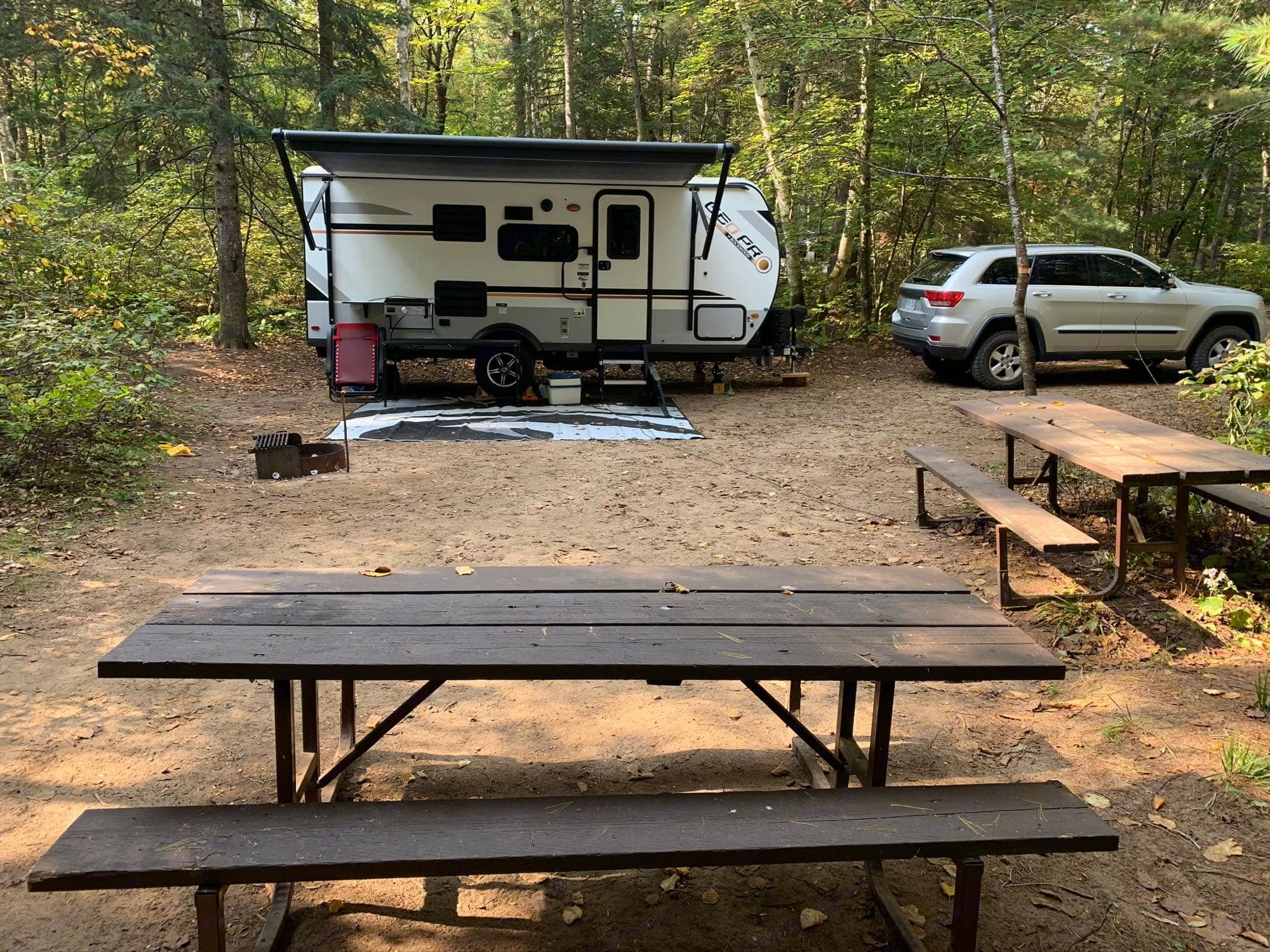 Compact trailer parked at your favorite spot, outdoor mat to keep the inside and outside tidy. Extend the awning and turn on the outdoor speaker.. Forest River Rockwood 2020