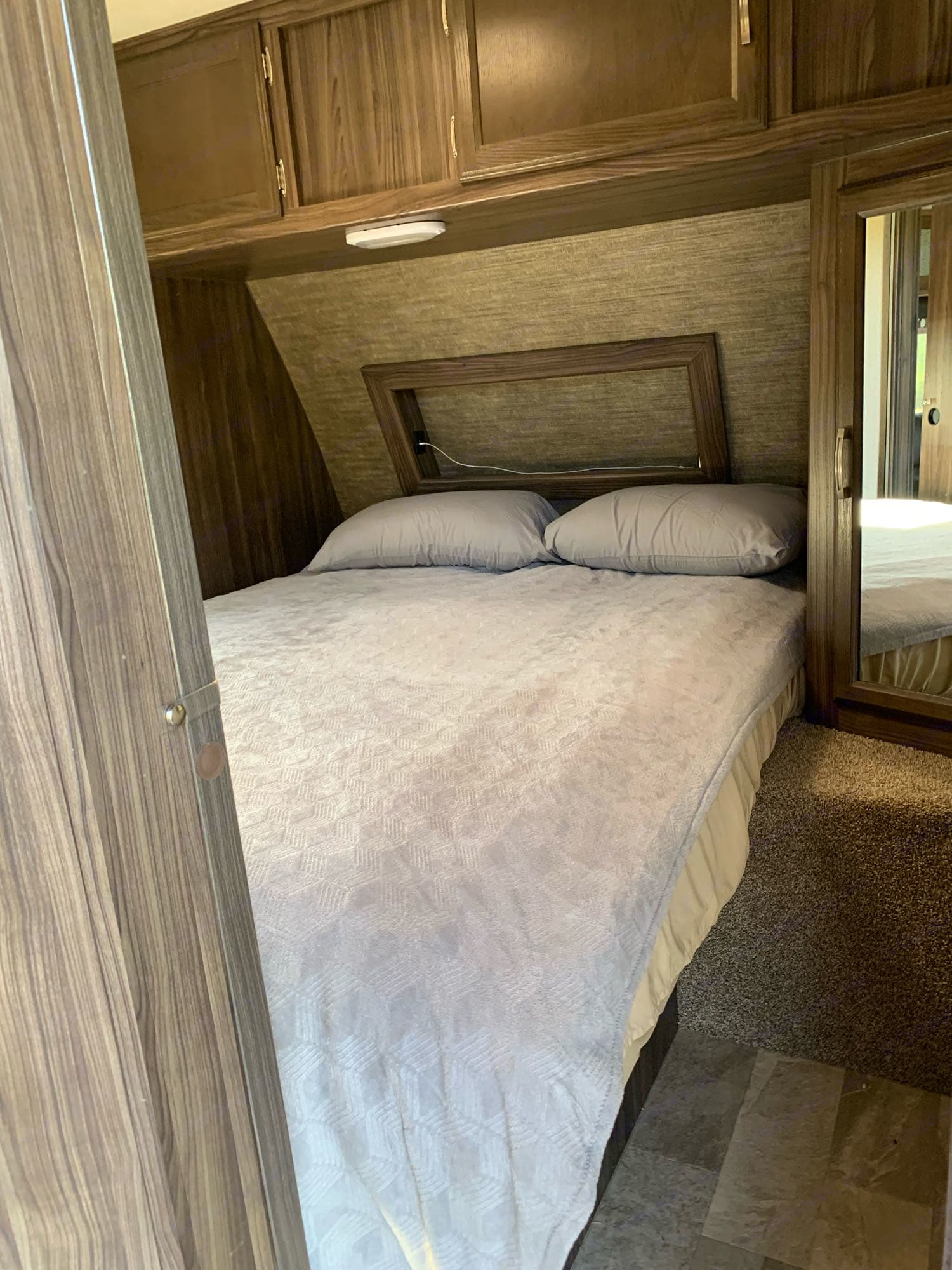 Queen size bed with a memory foam topper for added comfort.. Coachmen Apex 2018