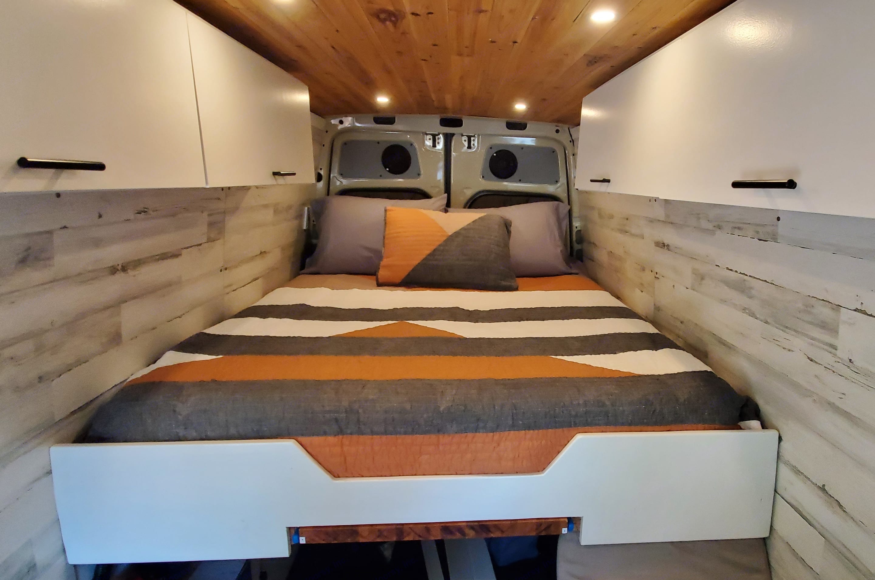 Queen size bed comfortably sleeps two. There's also a shelf in the rear which is perfect for holding your laptop/tablet and watching movies.. Mercedes-Benz Sprinter 2016