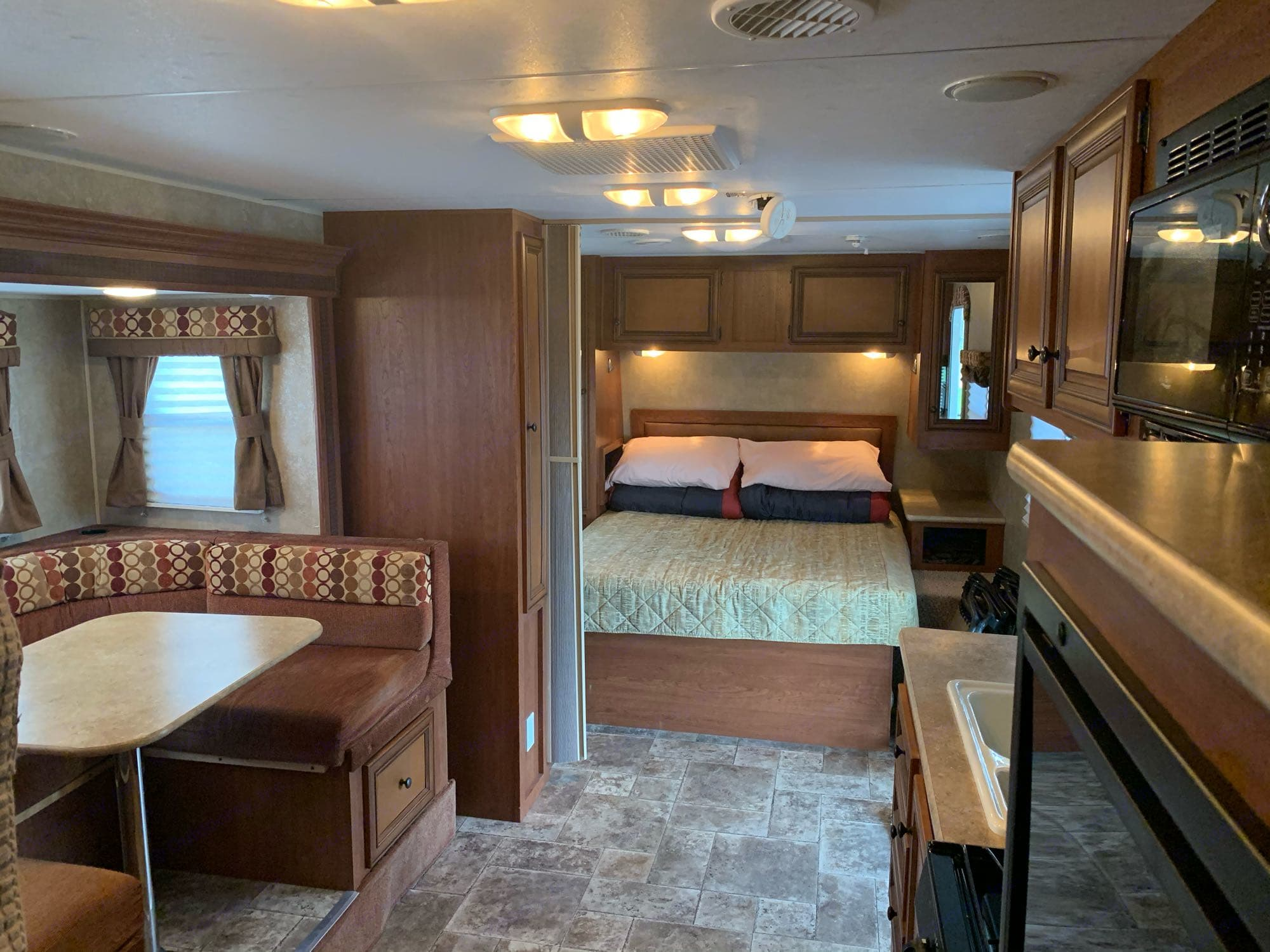 This bedroom queen-sized bedroom has plenty of storage space and an option privacy curtain-wall if you need.. K-Z Manufacturing Other 2012