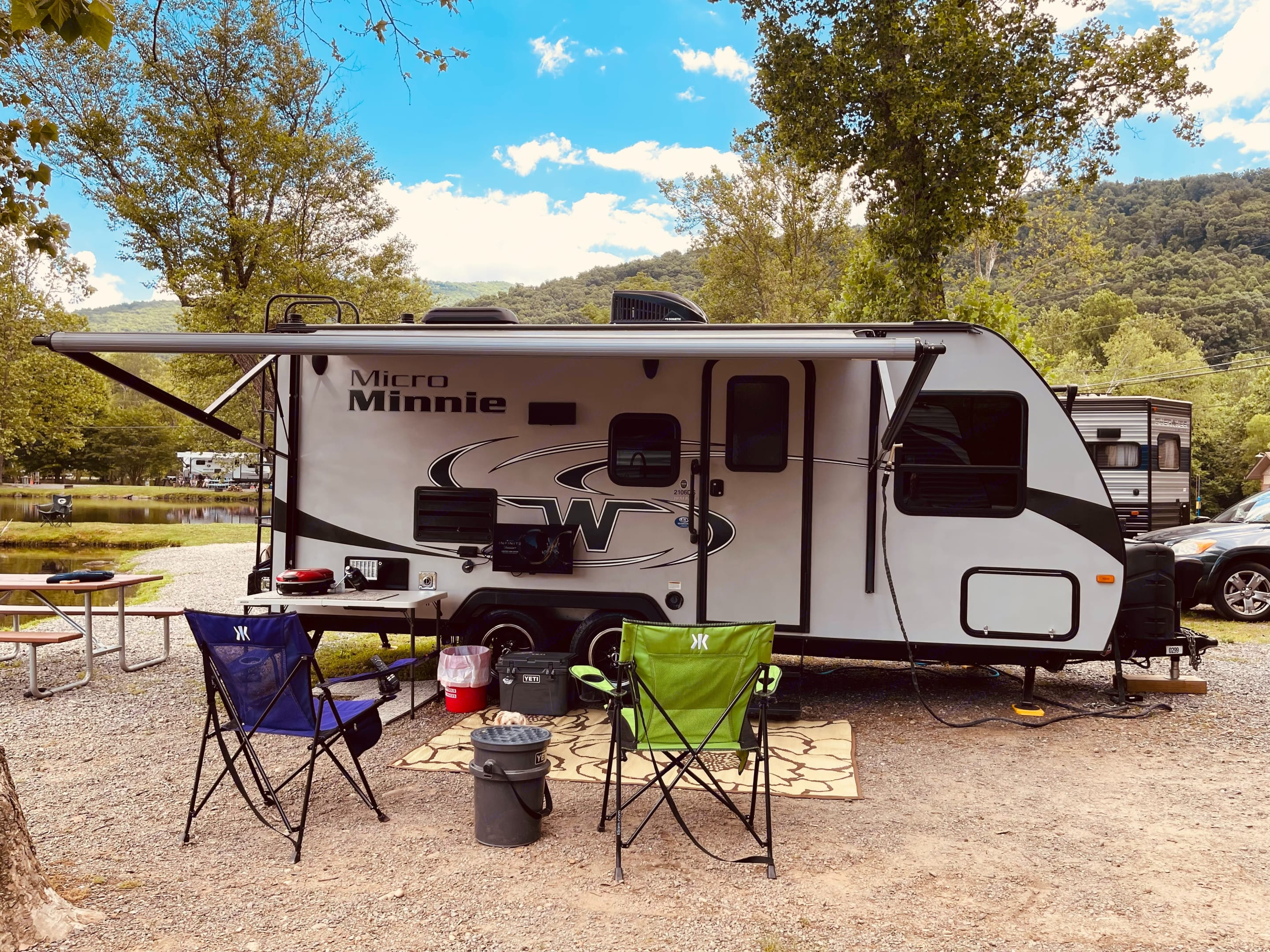 We supply you with 2 camp chairs, a folding table, outdoor rug, grill with one propane tank and an outdoor TV. Winnebago Micro Minnie 2017