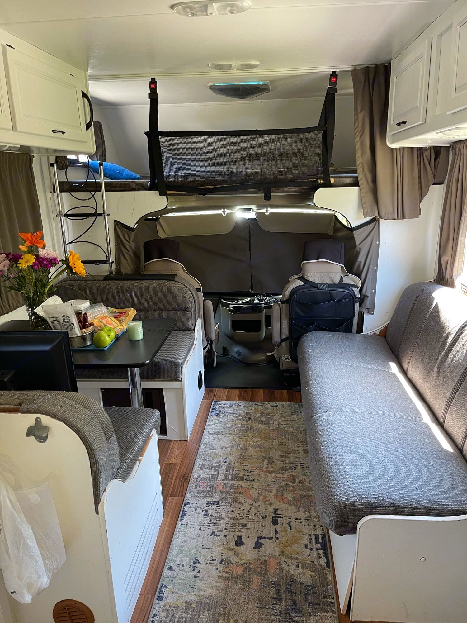 Standing in the kitchen facing the front, curtained up for privacy. The bunk over the cab also has net so falling out (kids or luggage) doesn't happen. Thor Motor Coach Four Winds Majestic 2014