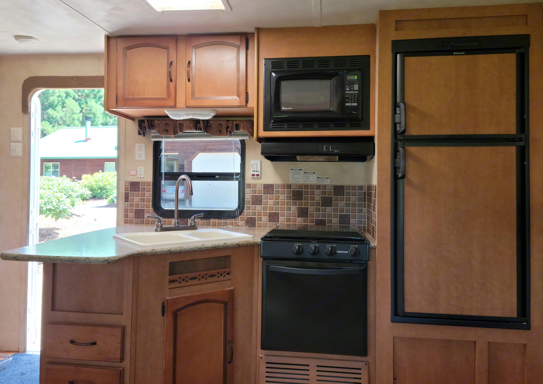 fridge, freezer, sink, oven, stove, microwave, storage. Puma 30kdb 2012
