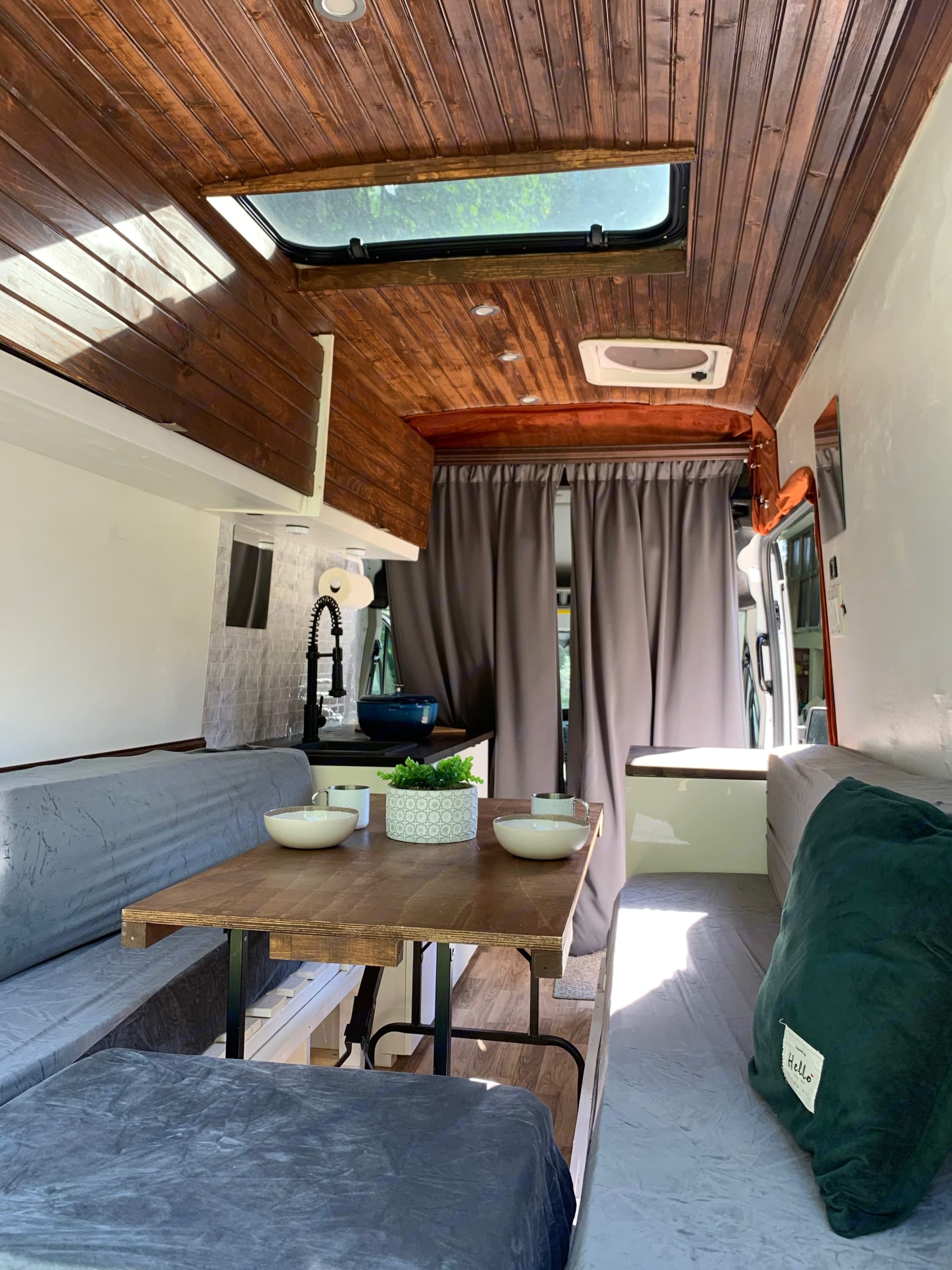Enjoy the bed-to-bench setting for eating or hanging out. Ford Custom Transit 2019
