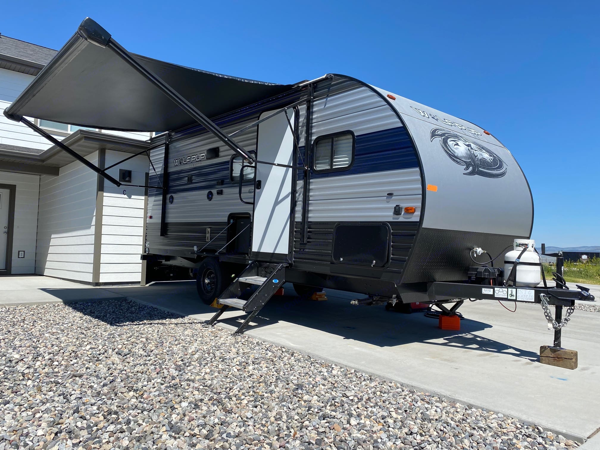 Side view with power awning. Forest River Cherokee Wolf Pup 2021