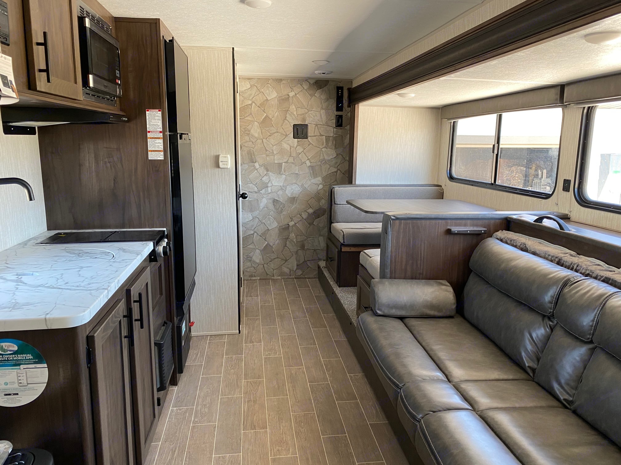 Photo taken from queen bed looking toward back of camper. The door is to the left, before the counter.. Forest River Cherokee Wolf Pup 2021