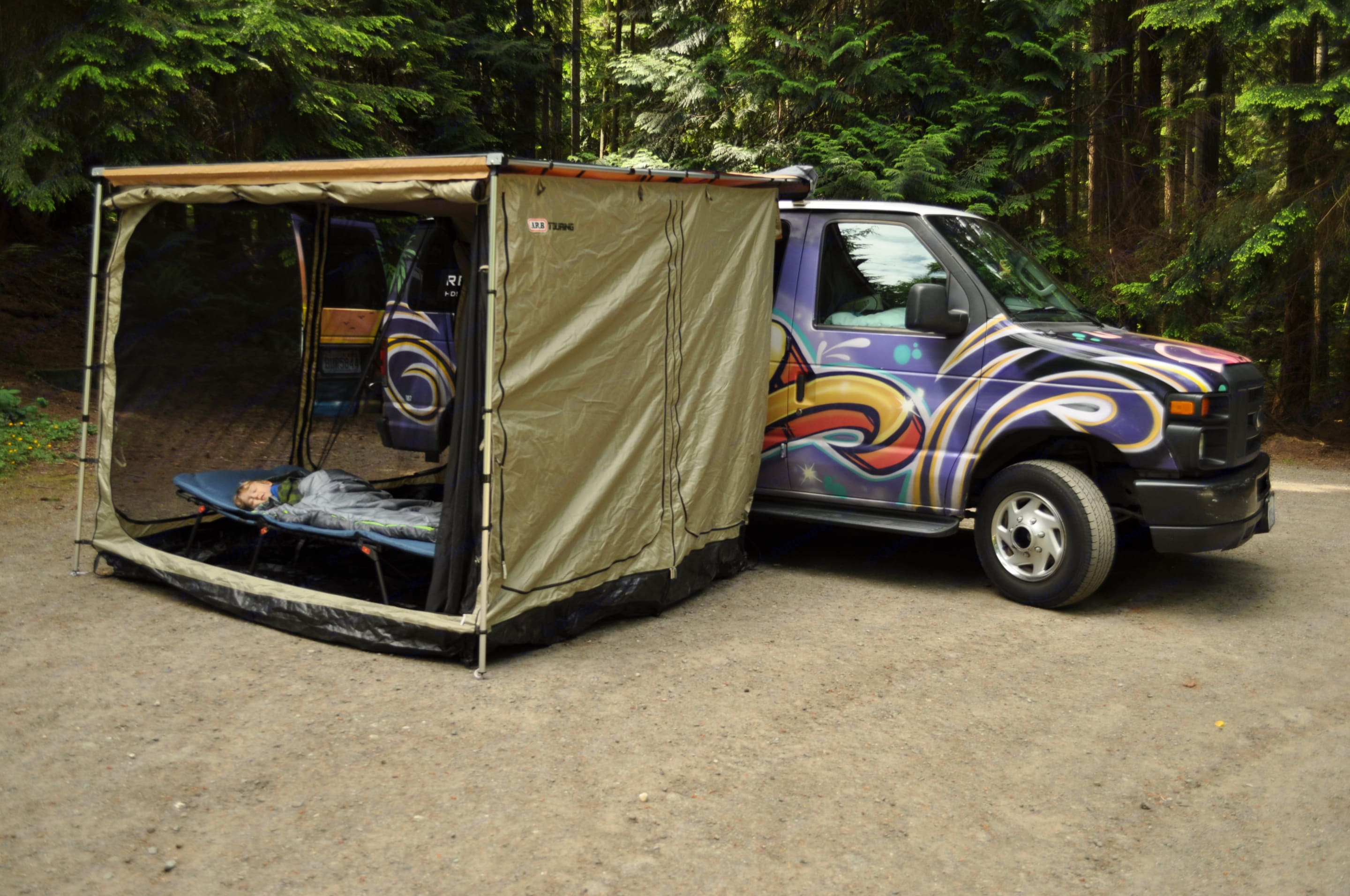 """An awning room so all the kids can sleep """"outside!"""" Mosquito net or tent walls for privacy and protection from weather and bugs.. Ford E250 Campervan 2009"""