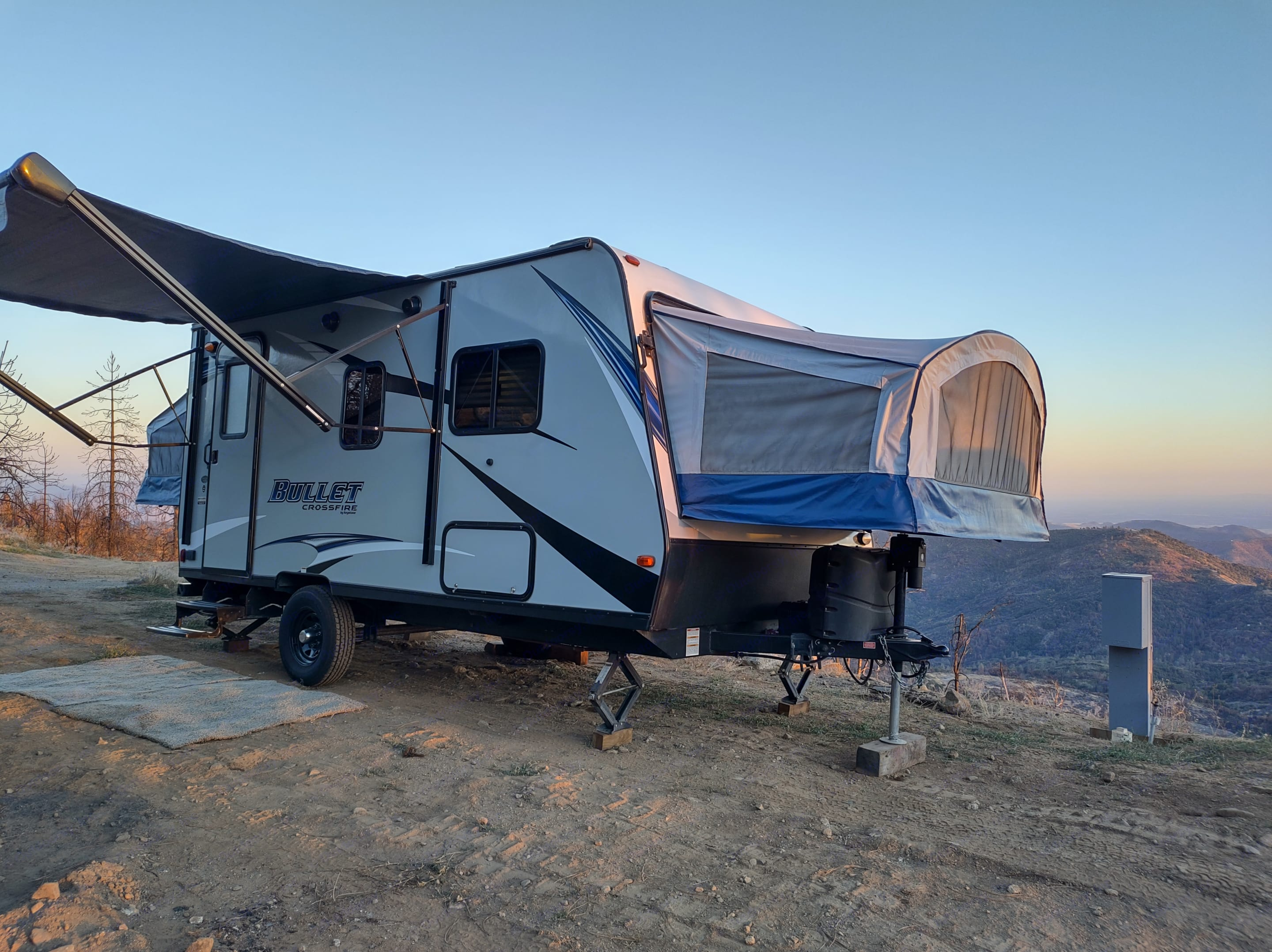 The exterior with everything put up. One person can put the queen beds out and back together.. Keystone Bullet 2018