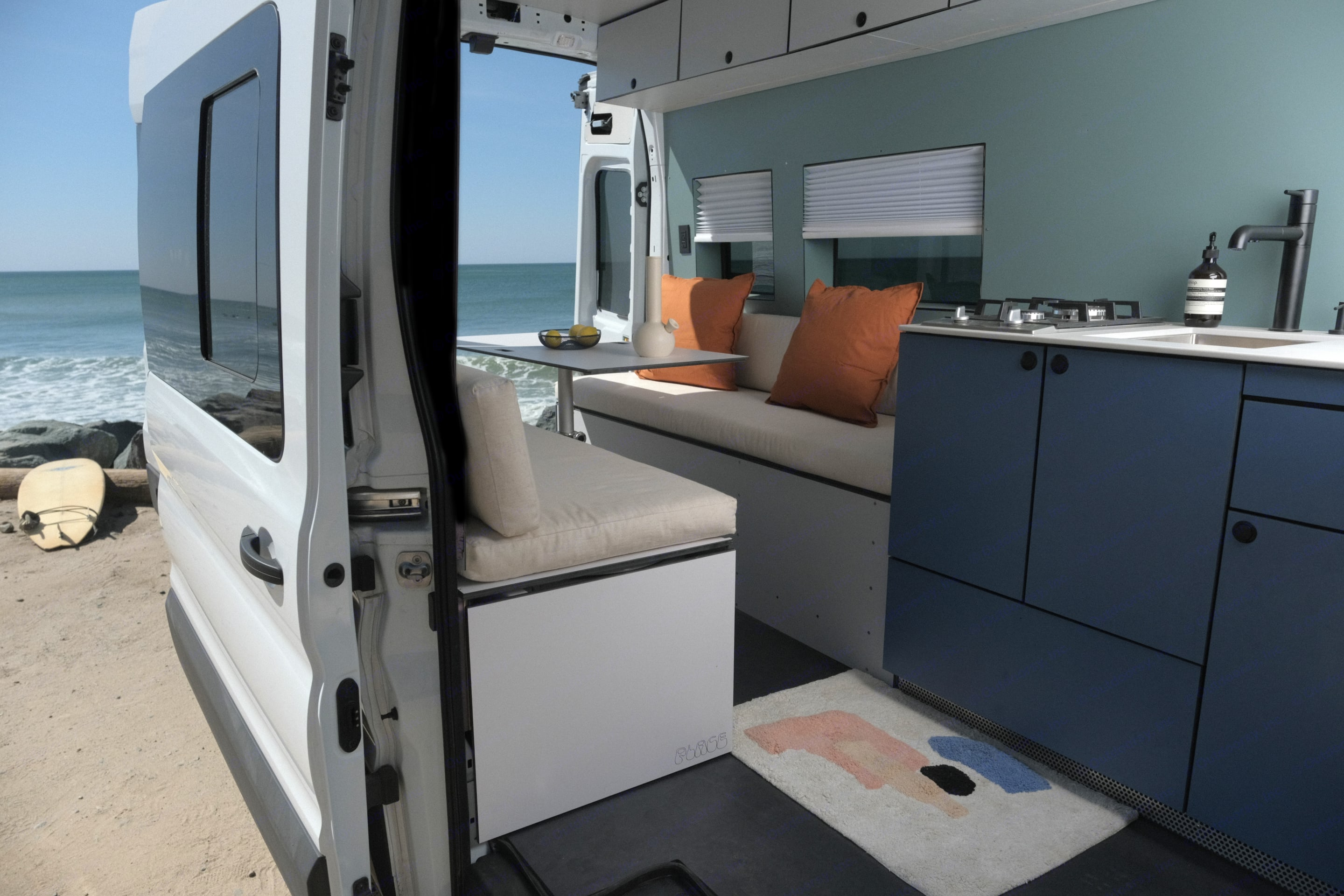 Kitchen and dinning table lowers down and two leafs are added to convert into sleeping area. Ford Transit 250 2020