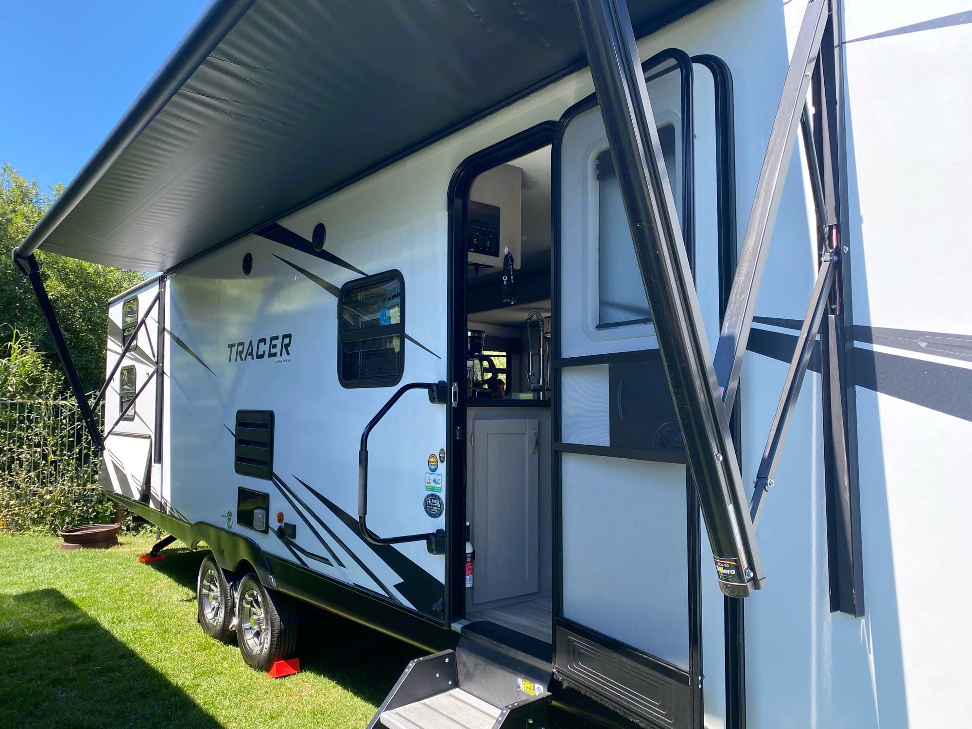 Awning shown partially extended.. Forest River Tracer 2021