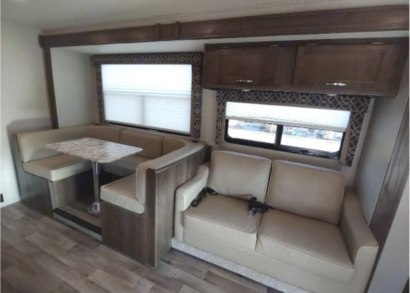 Interior of motor home, seating areas - slide-out not extended.. Jayco Redhawk 2019